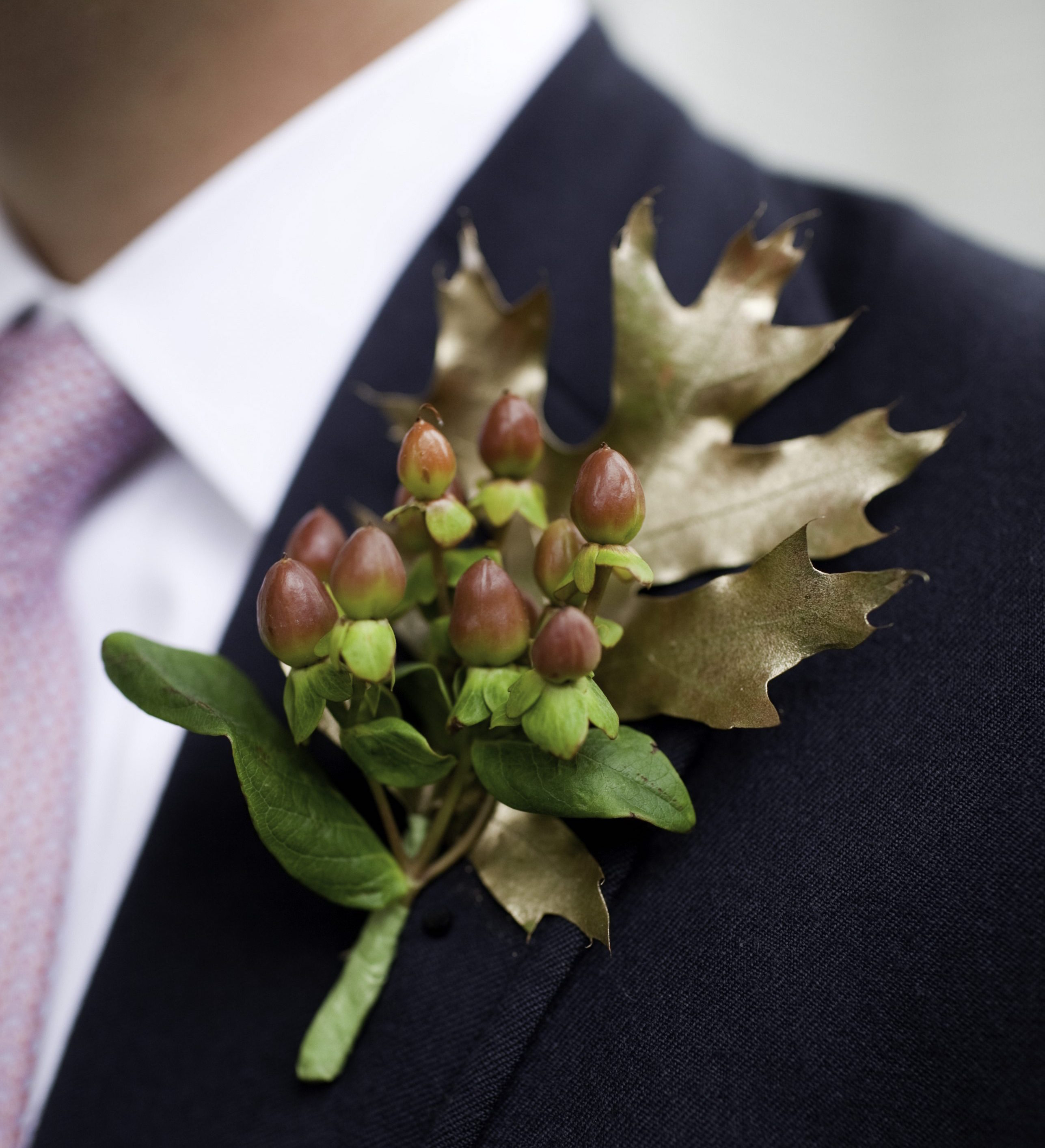 Gold leaf with red berry boutonniere