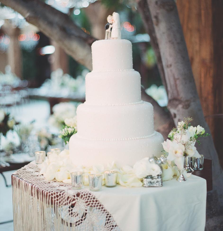 White fondant on layered wedding cake outdoor wedding
