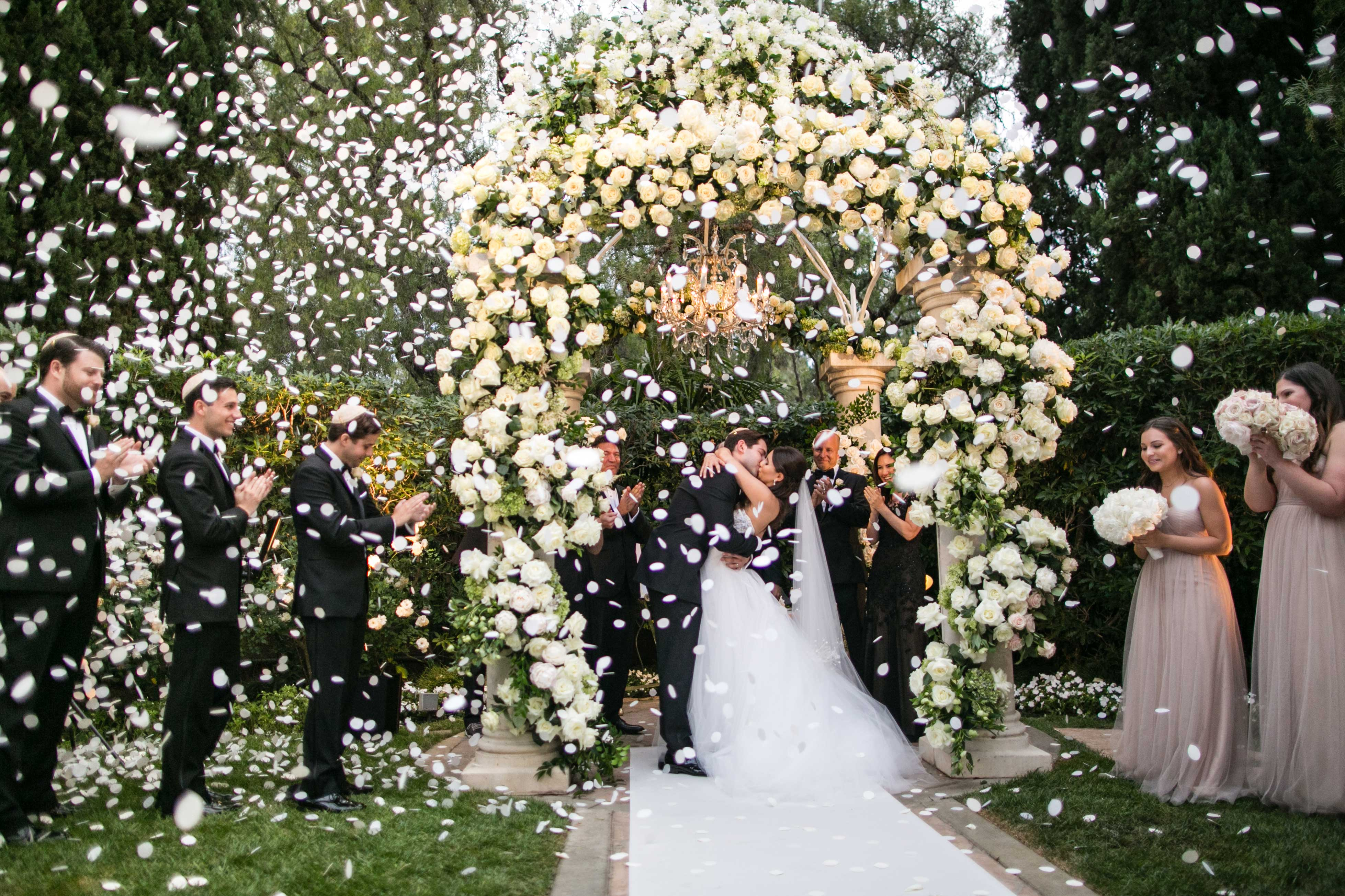 Flower petal explosion at wedding ceremony