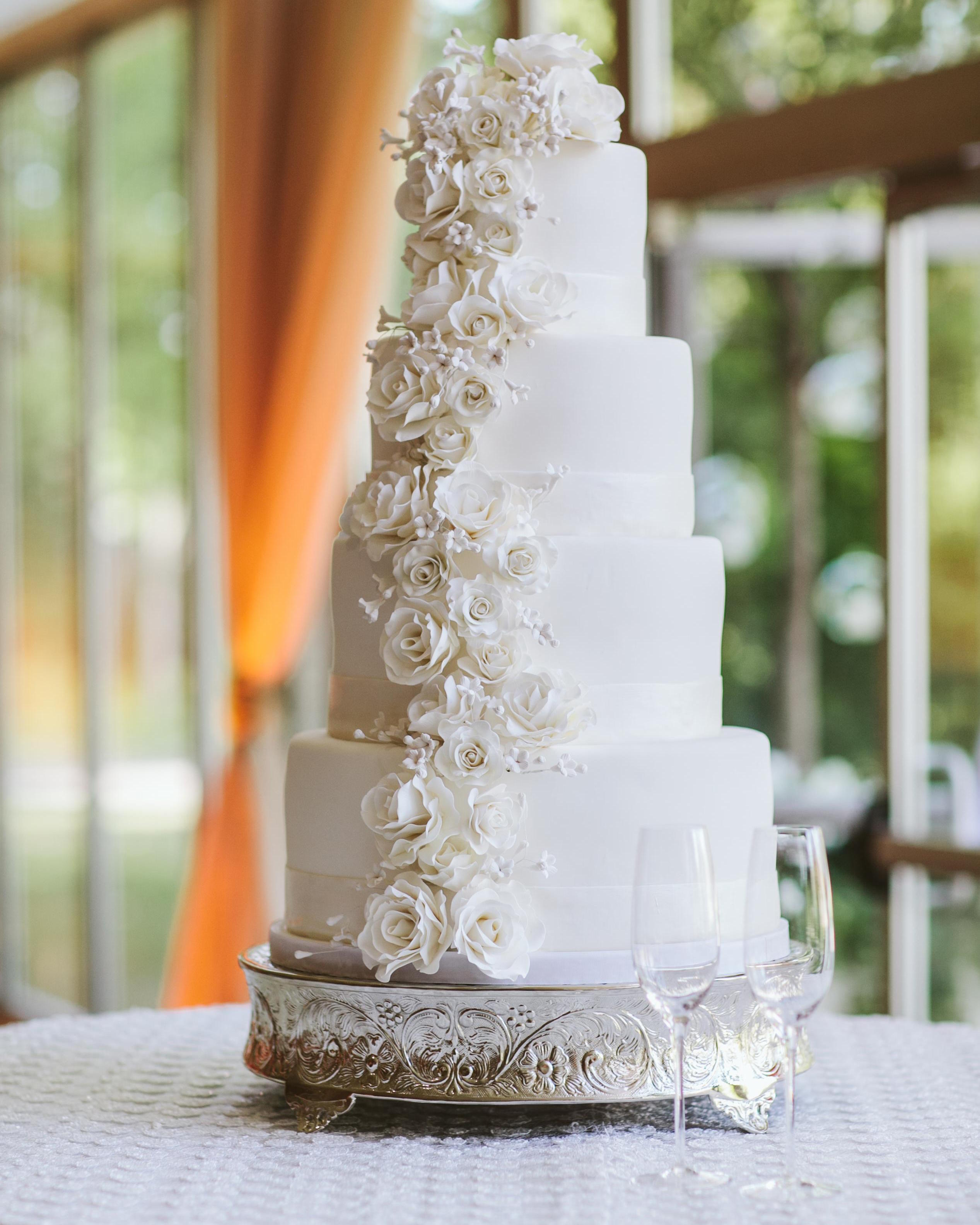 Tall white wedding cake with sugar flowers