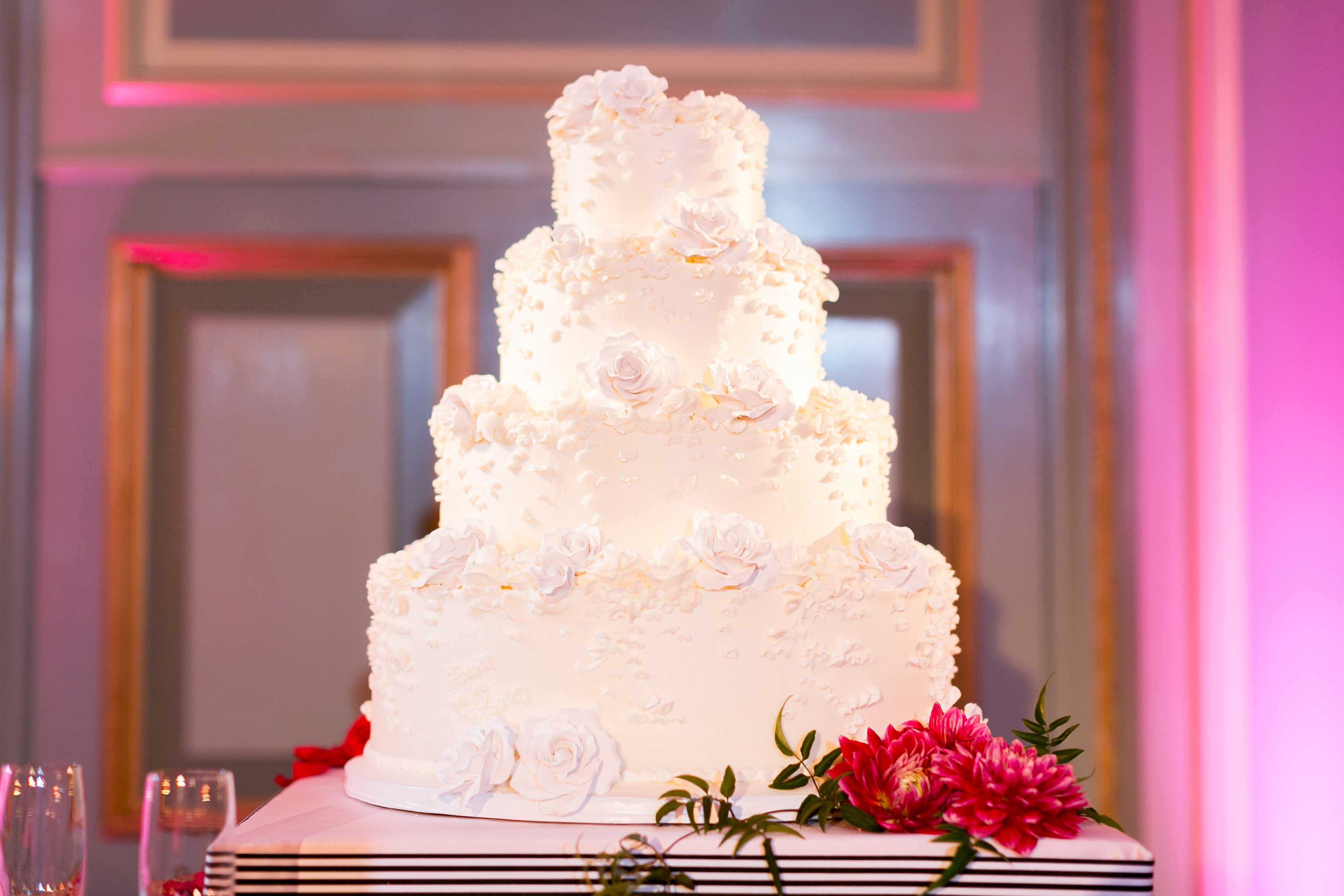 Classic white wedding cake with flower decorations