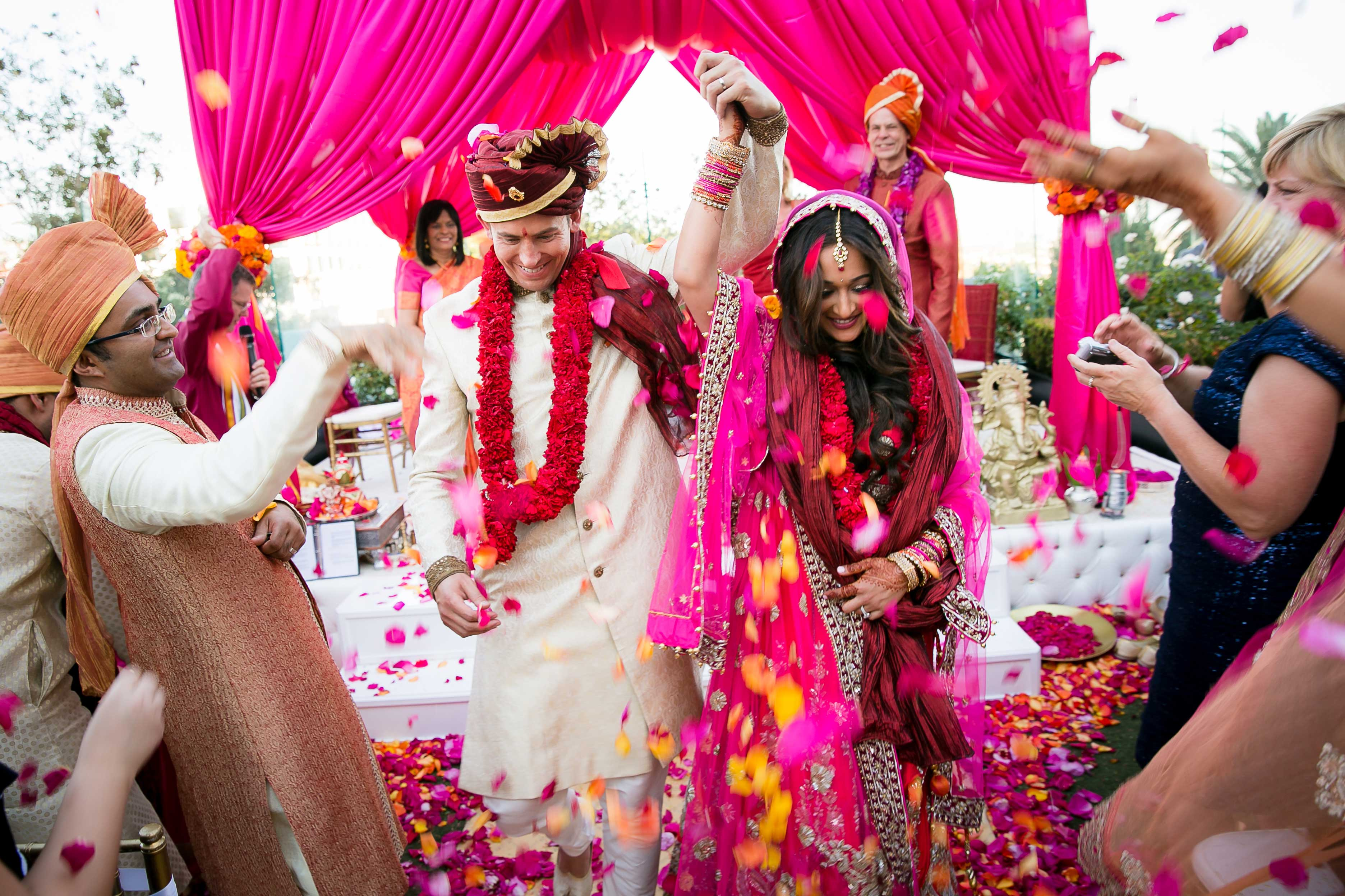 Bright flower petal toss Indian wedding ceremony exit