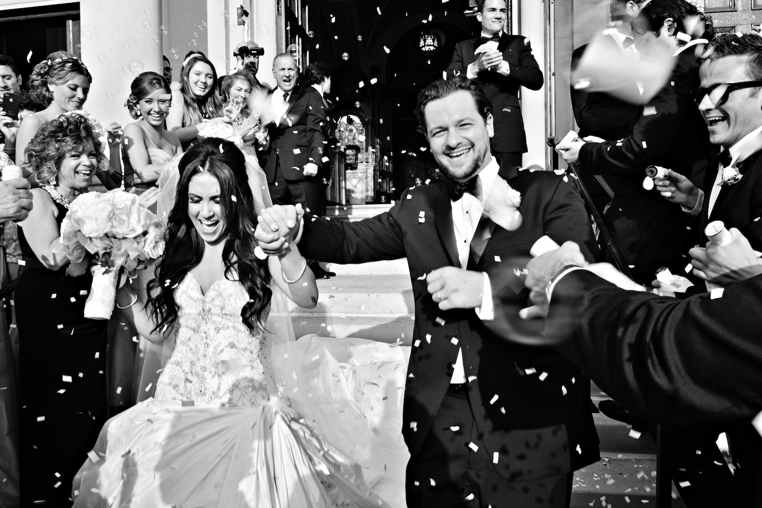 Black And White Photo Of Confetti Toss Wedding Leaving Church