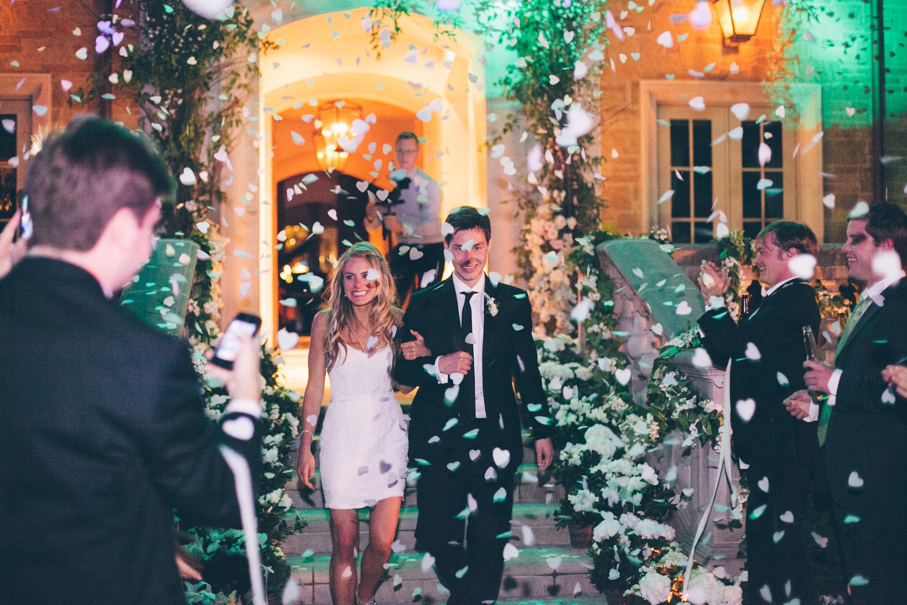 Bride in short wedding dress large heart shape confetti toss exit