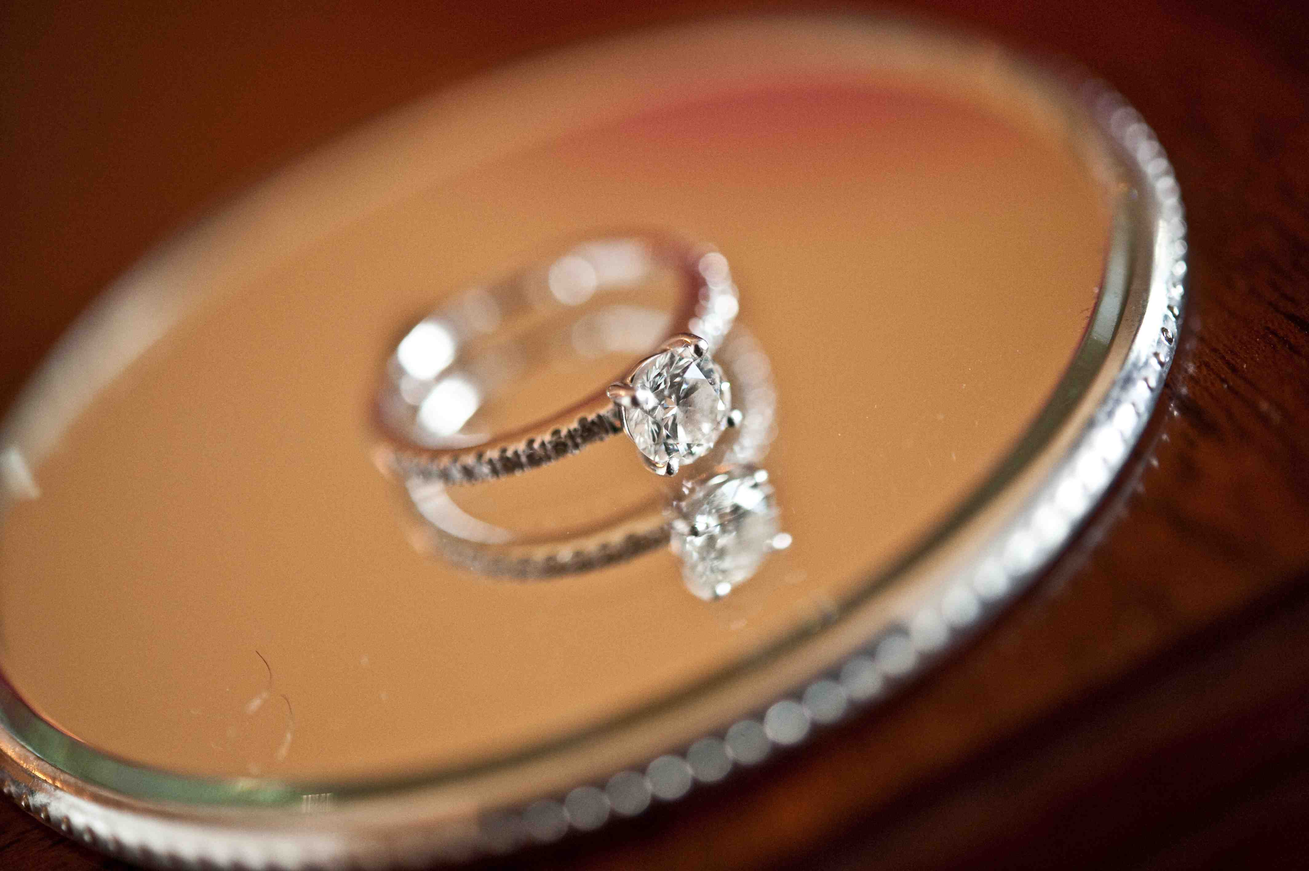 laura prepon engagement ring inspiration, round brilliant diamond, four prong, pave band