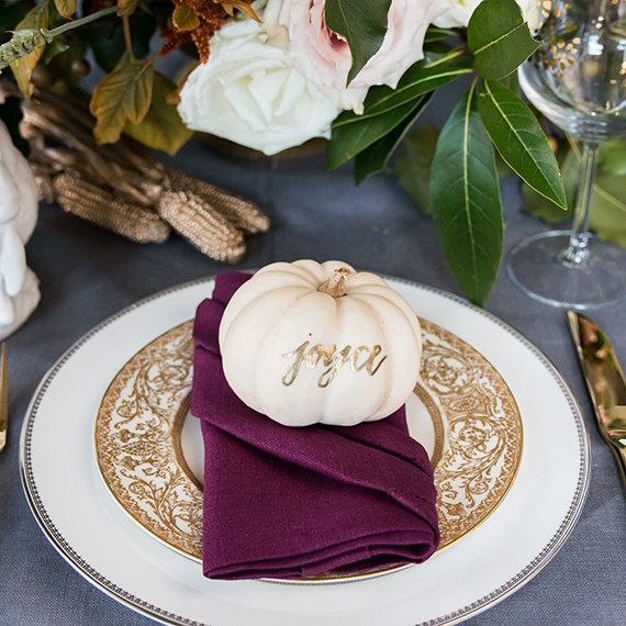 White pumpkin place marker wedding with gold calligraphy