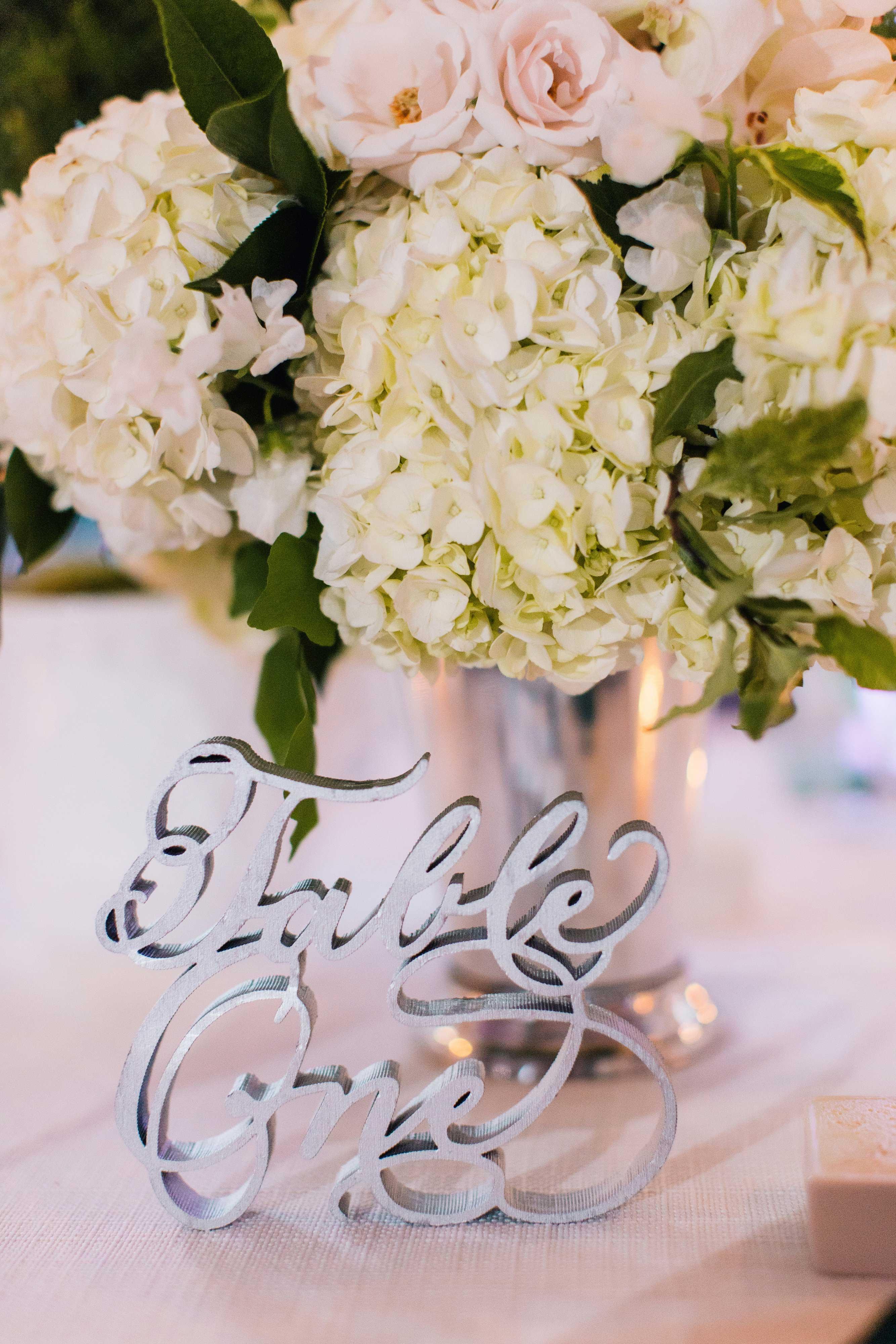 laser cut silver table number in cursive script