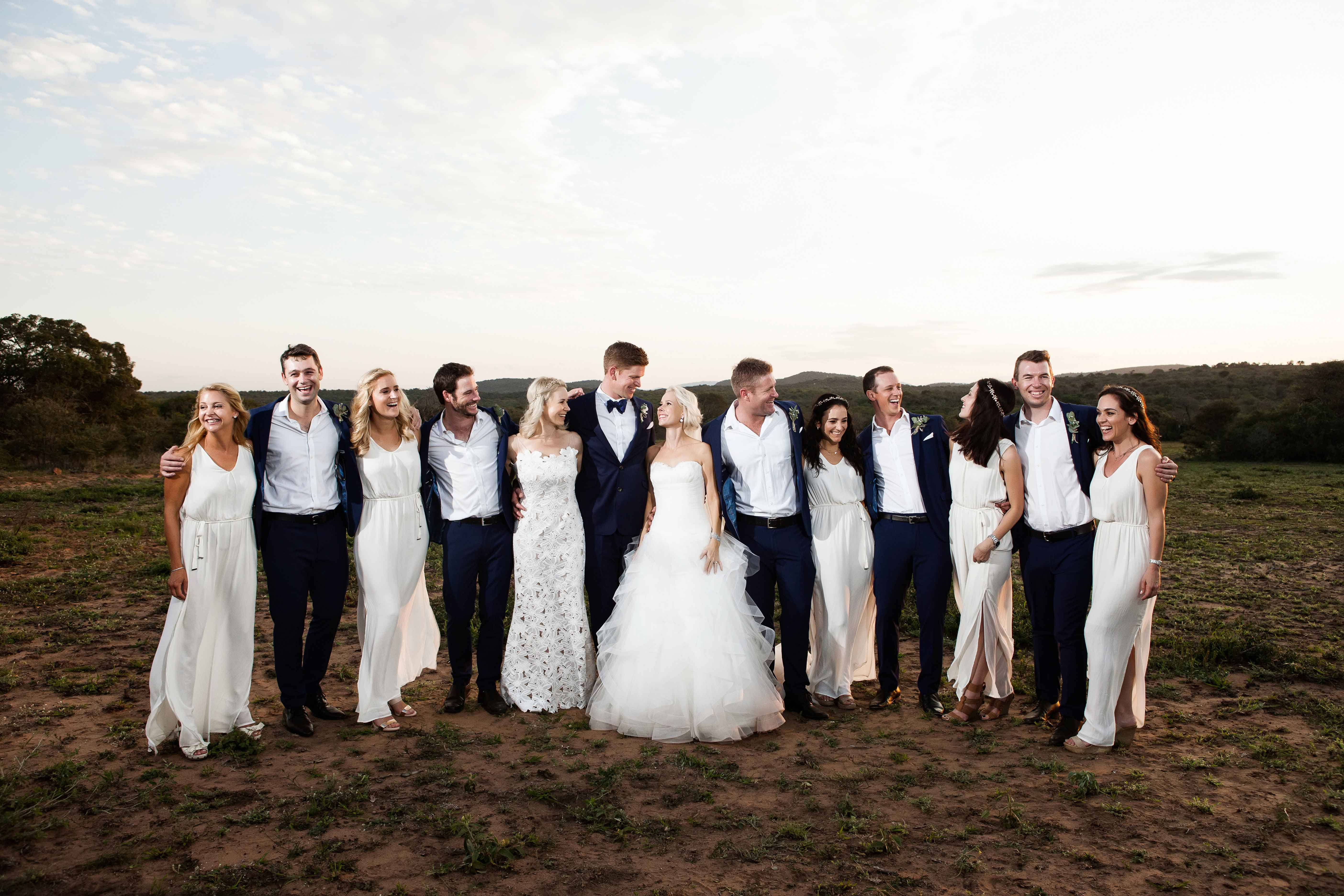 Navy blue groomsmen suits and white bridesmaid dresses