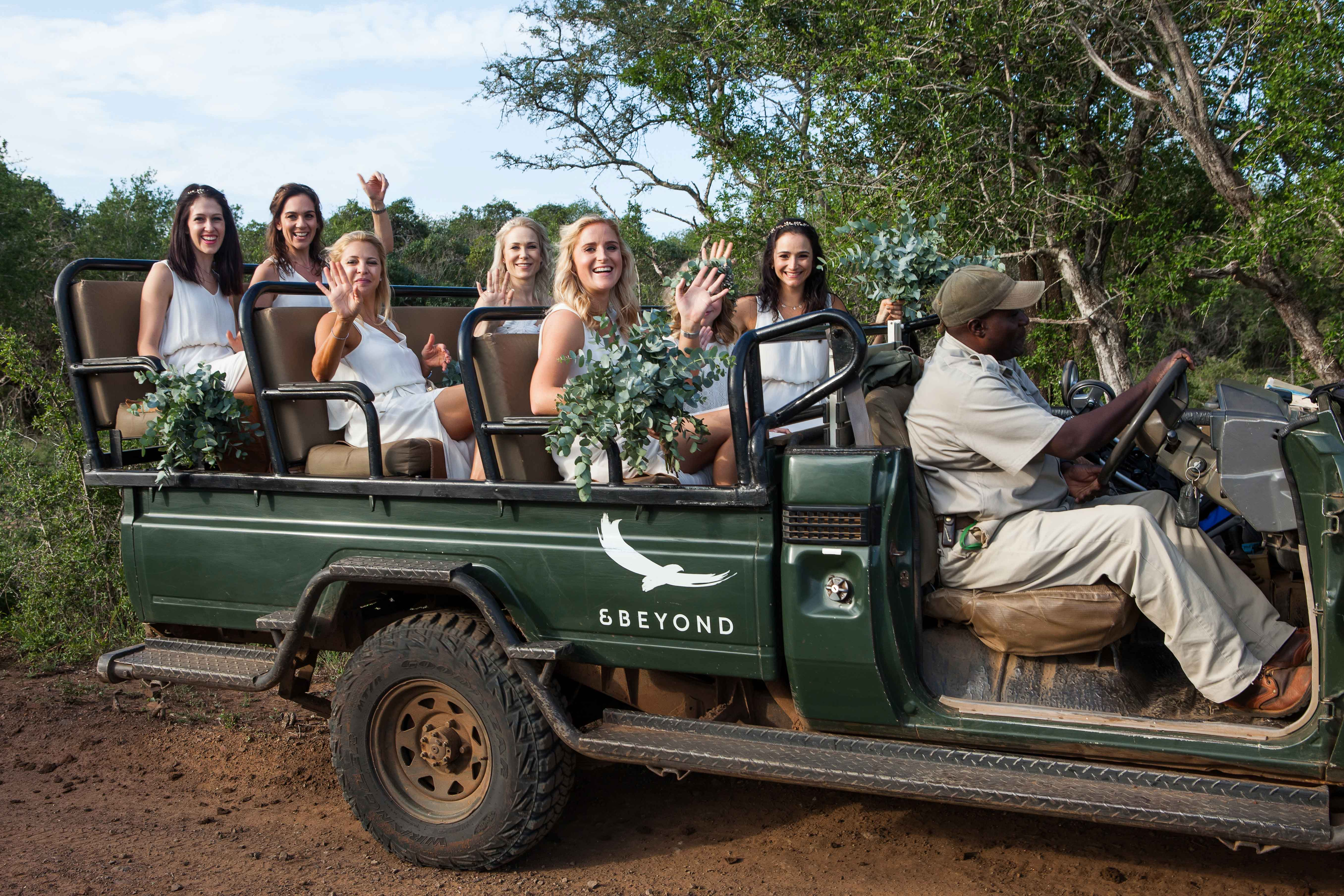 Bridesmaids in green safari Jeep for ceremony transportation