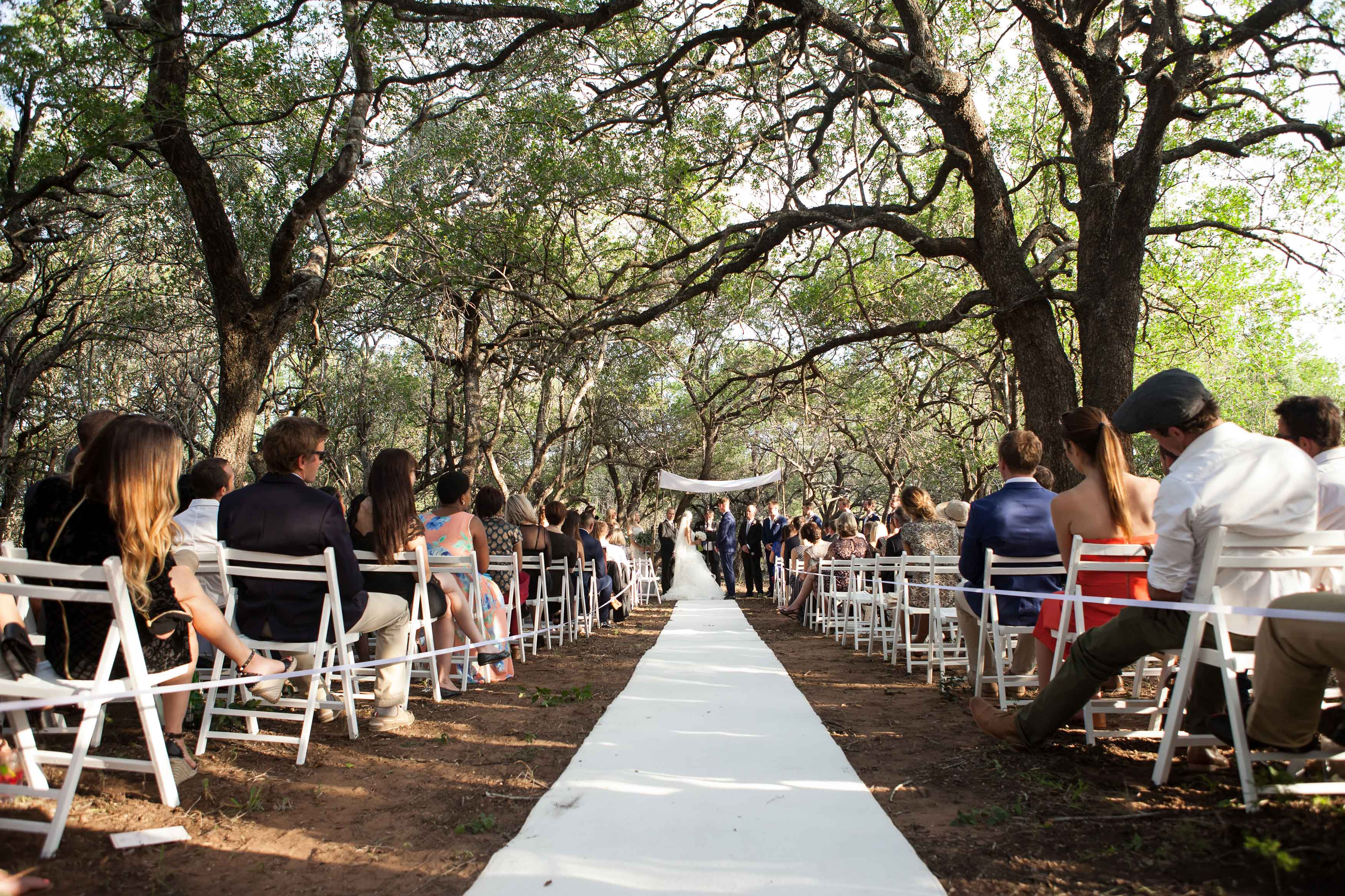 Simple white wedding ceremony at outdoor venue in South Africa