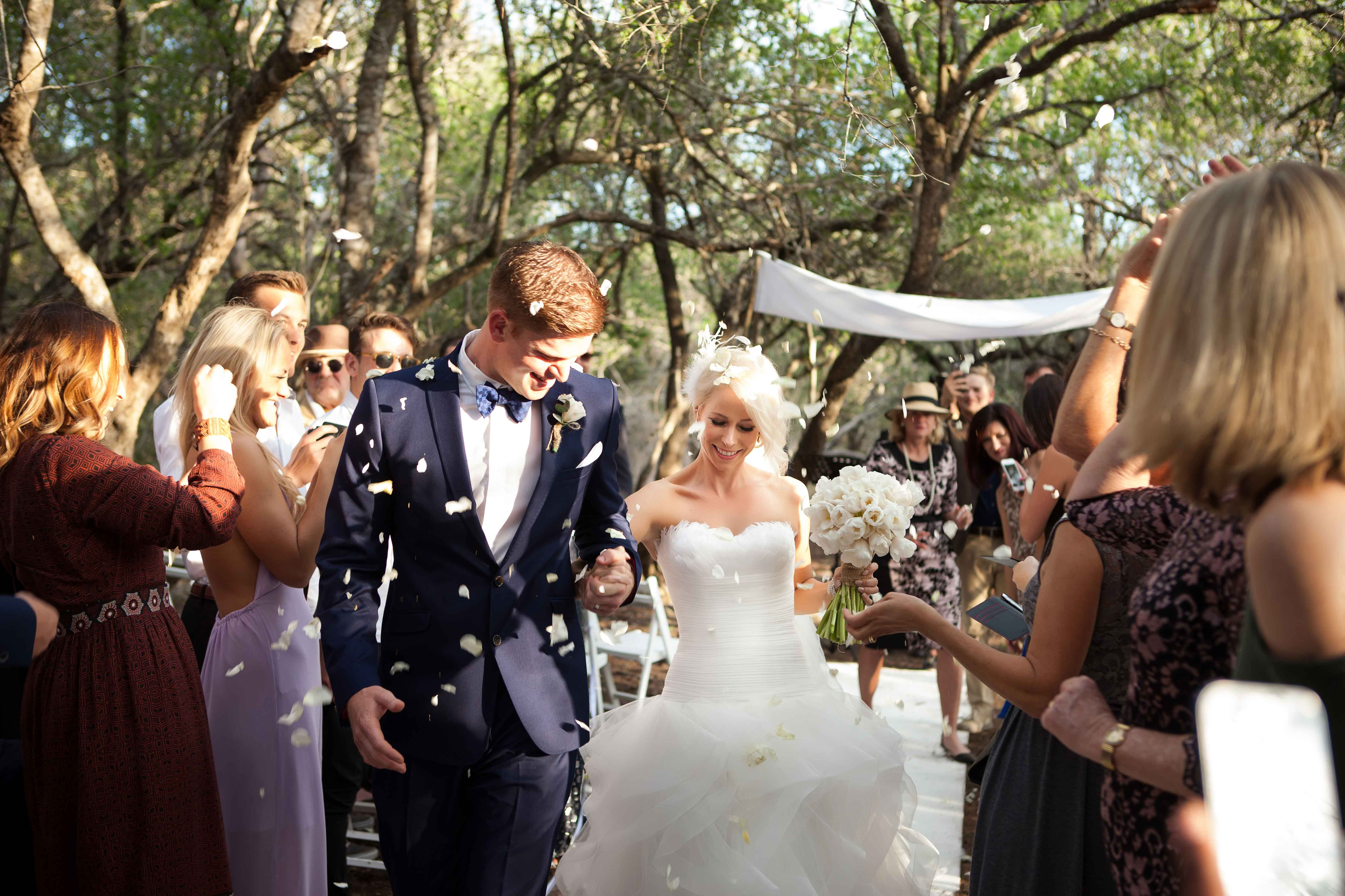 Flower petal toss at South Africa outdoor wedding ceremony