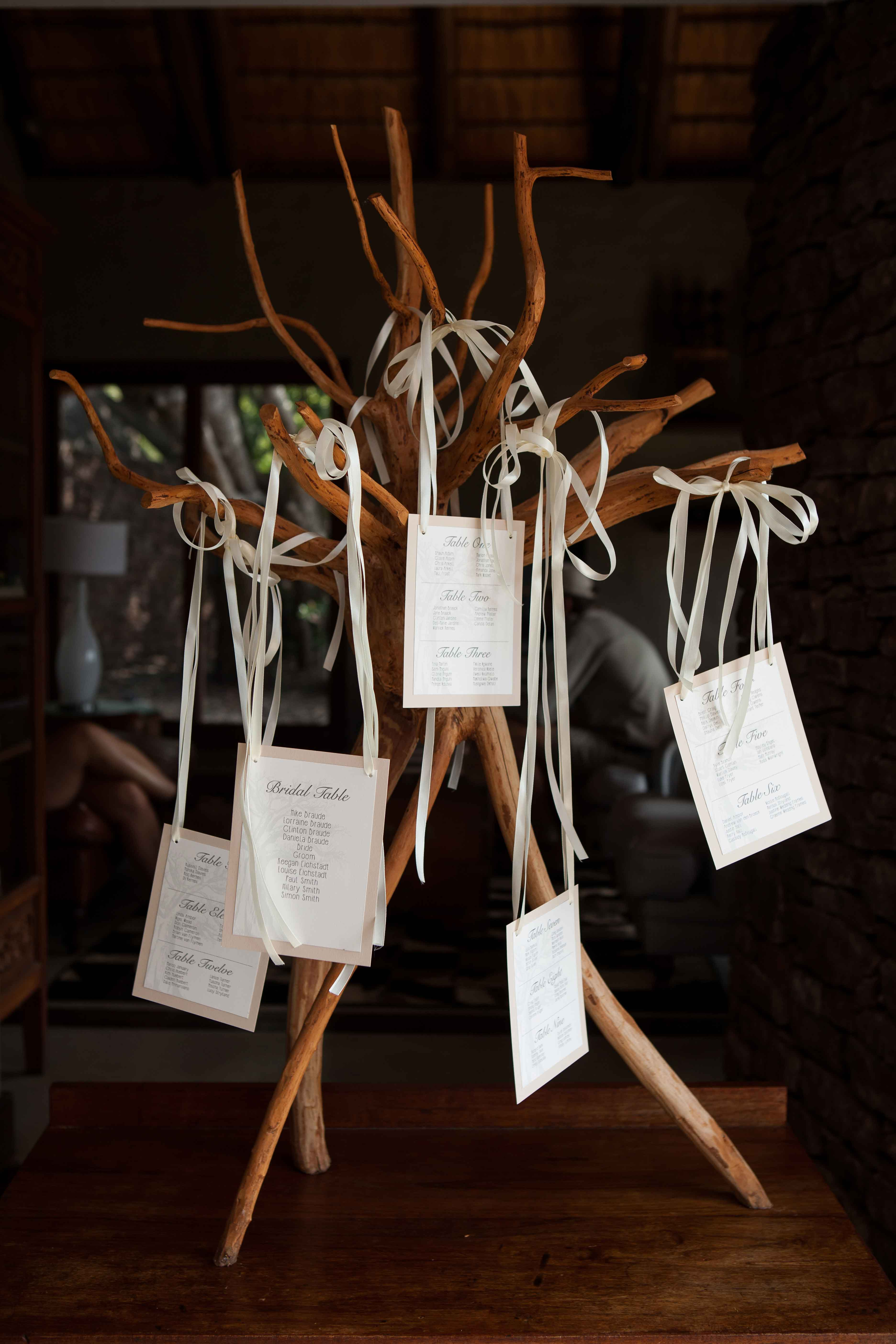Table numbers hanging from wooden sculpture