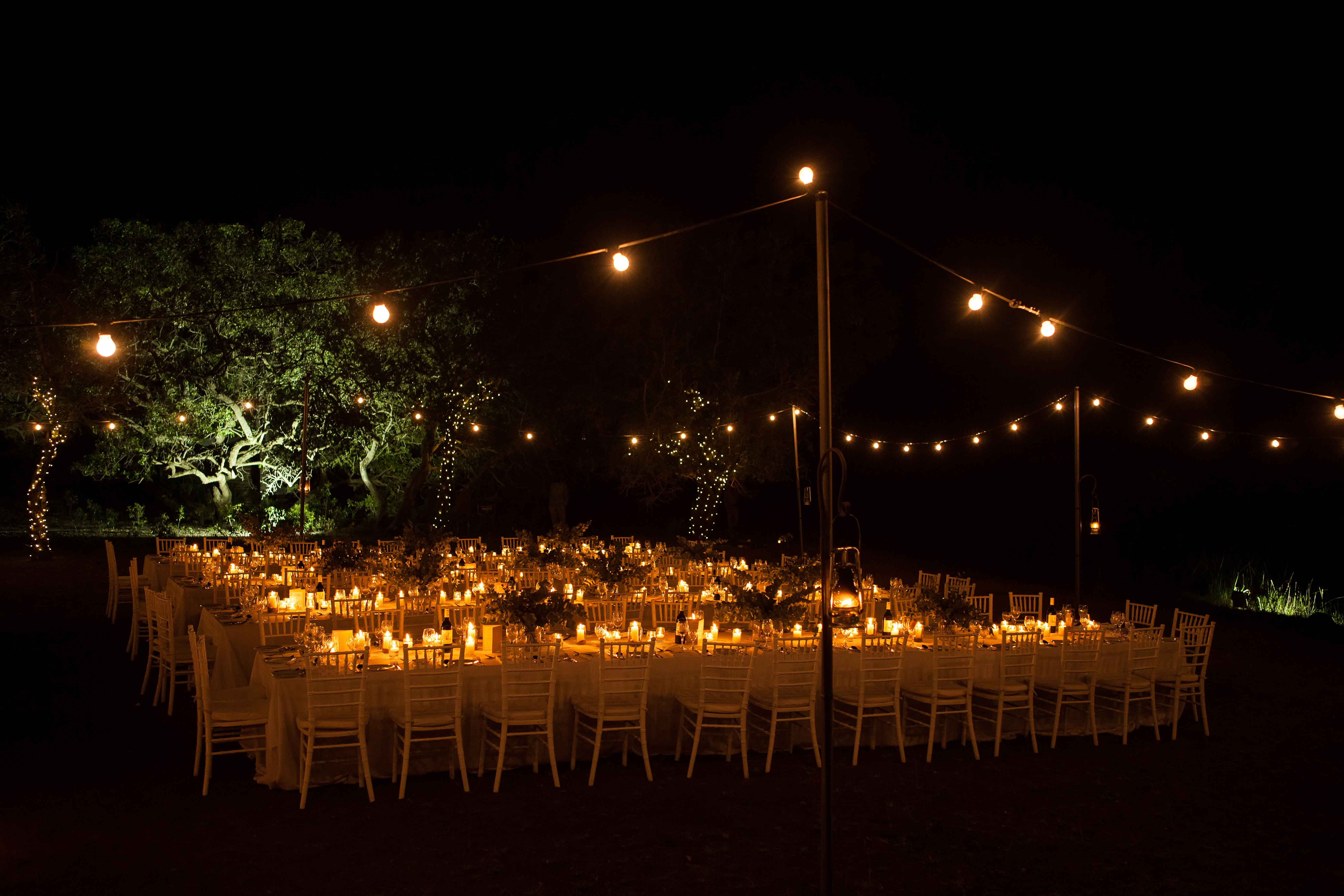 Dimly lit outdoor wedding reception in South Africa