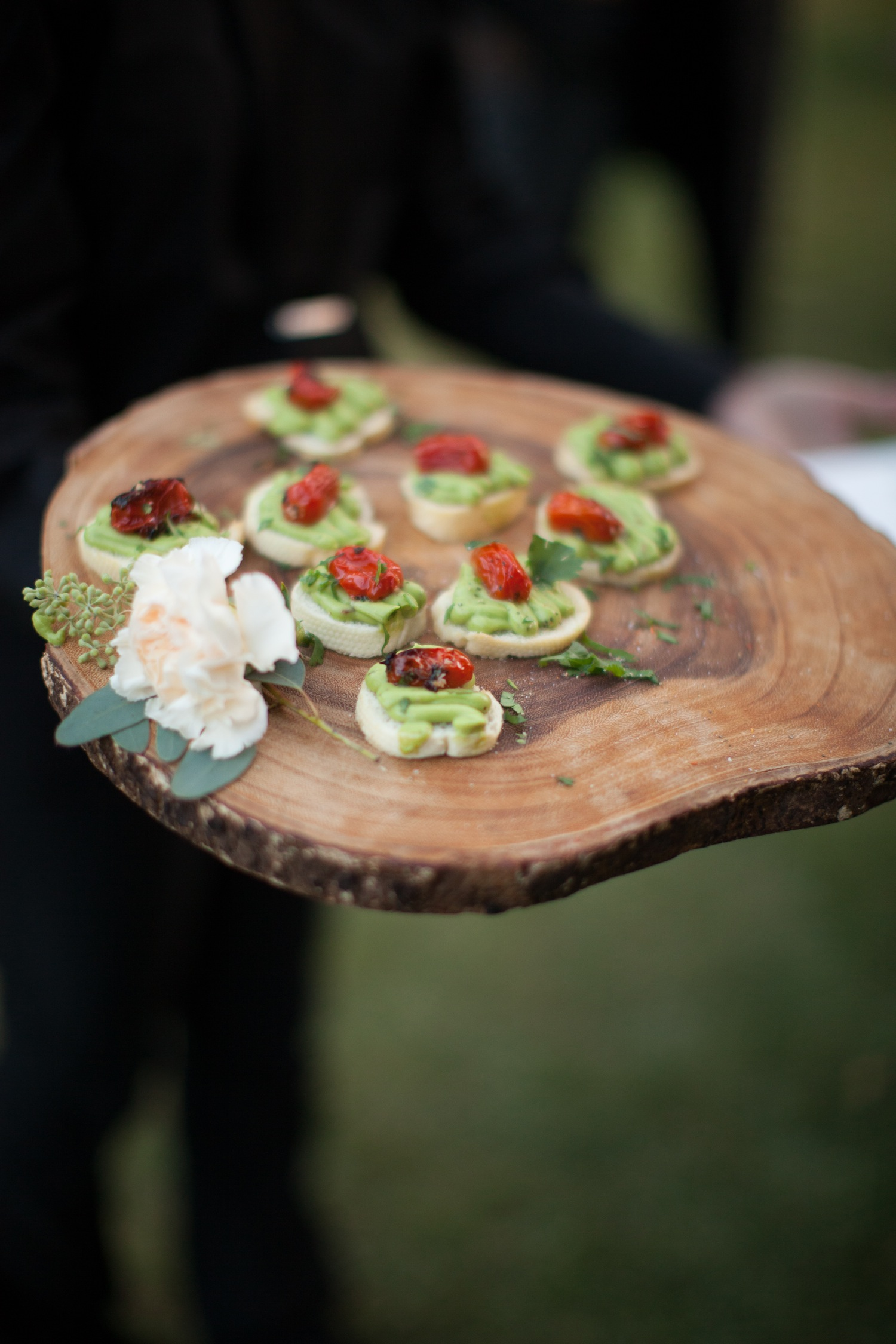 slice of tree trunk as serving platter for cocktail hour appetizers