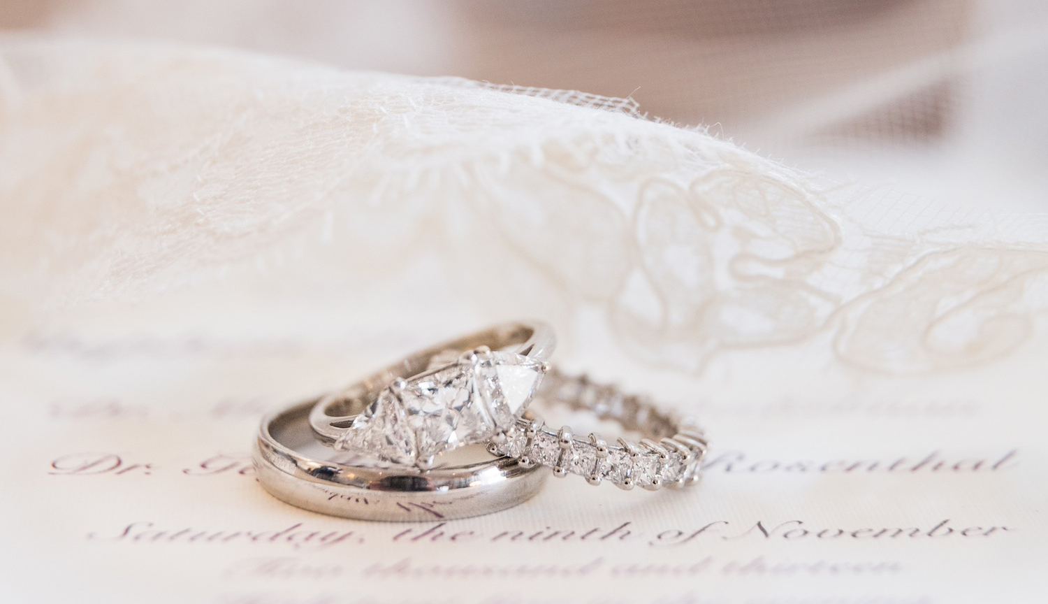 three-stone engagement ring, princess-cut diamond with triangle sidestones