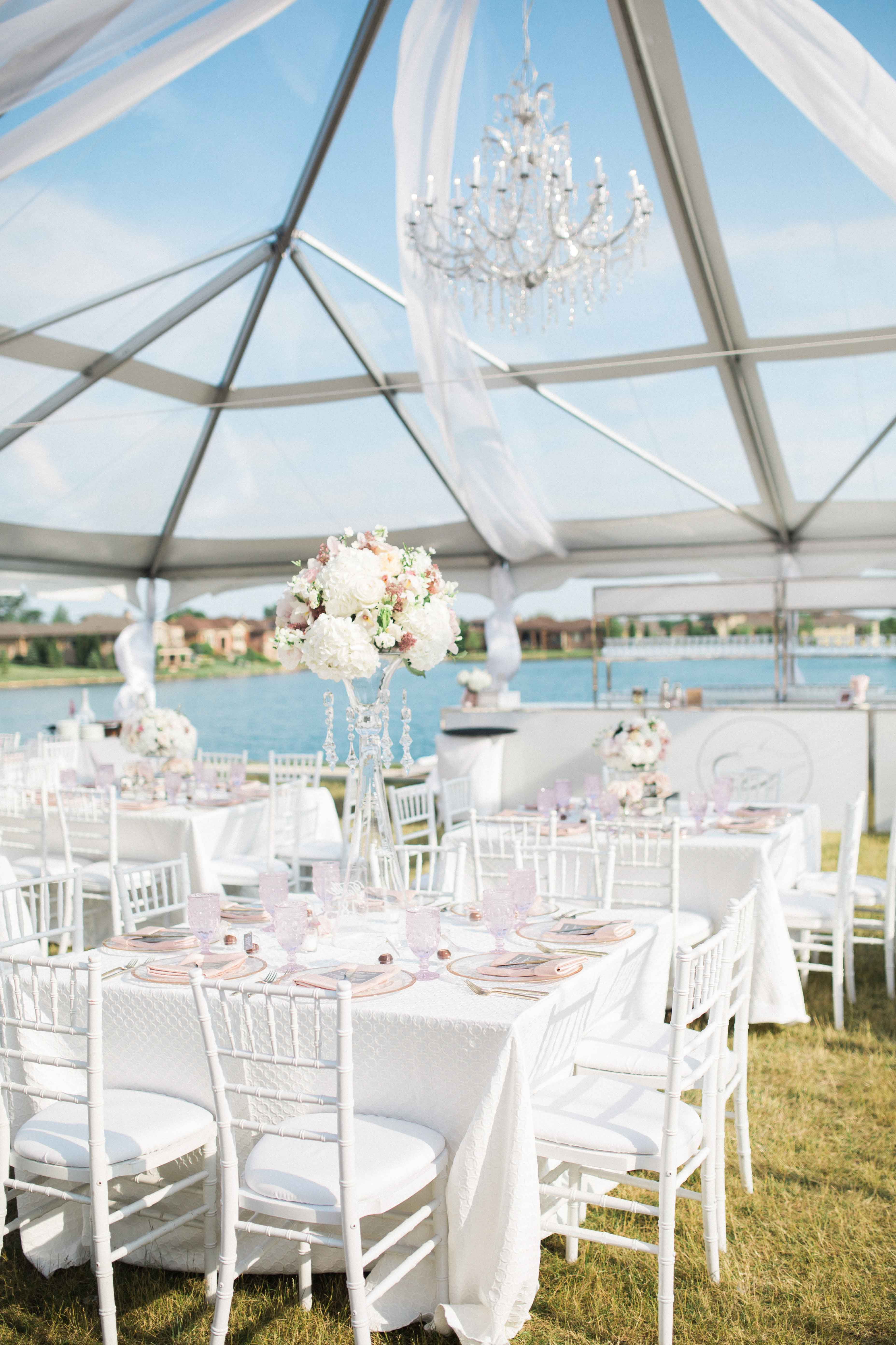 Clear top wedding tent with pink and white reception decor