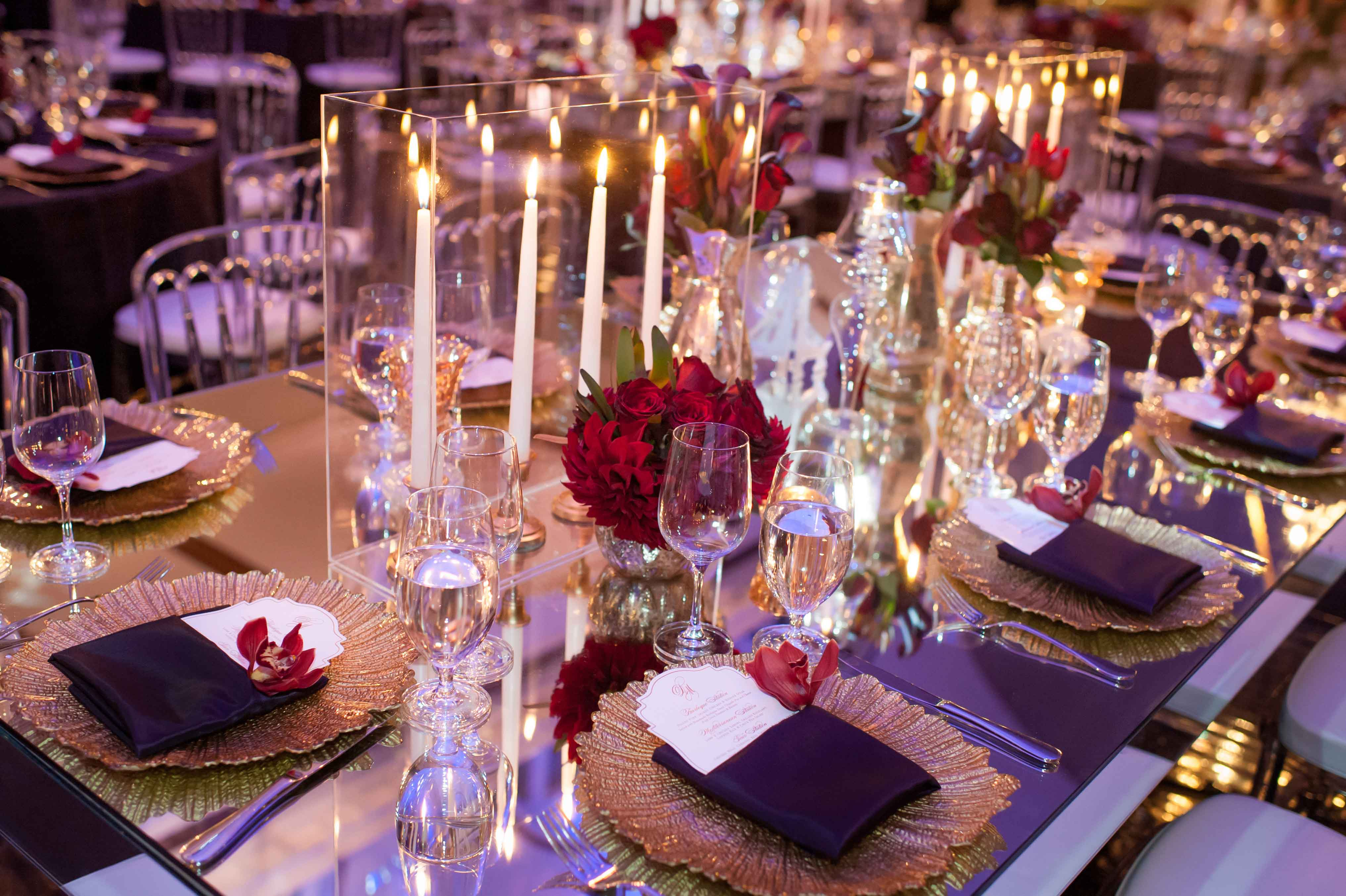 Purple theme wedding reception with candles and Lucite boxes