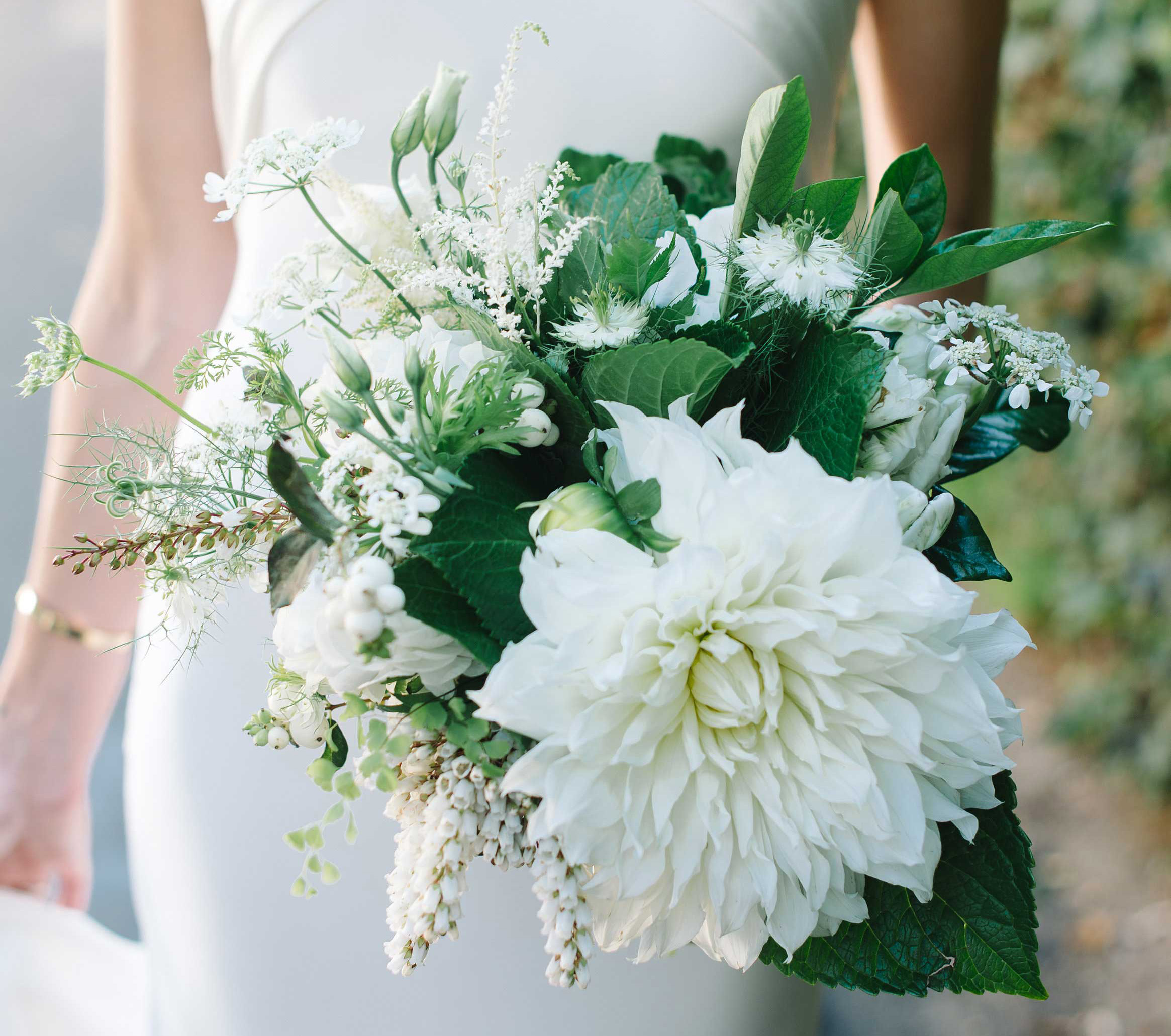 white bridal bouquet with large dahlia and greenery