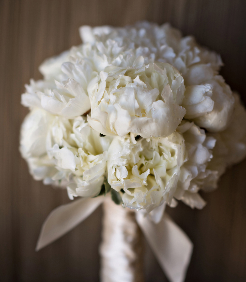 bridal bouquet with white peonies and morning dew