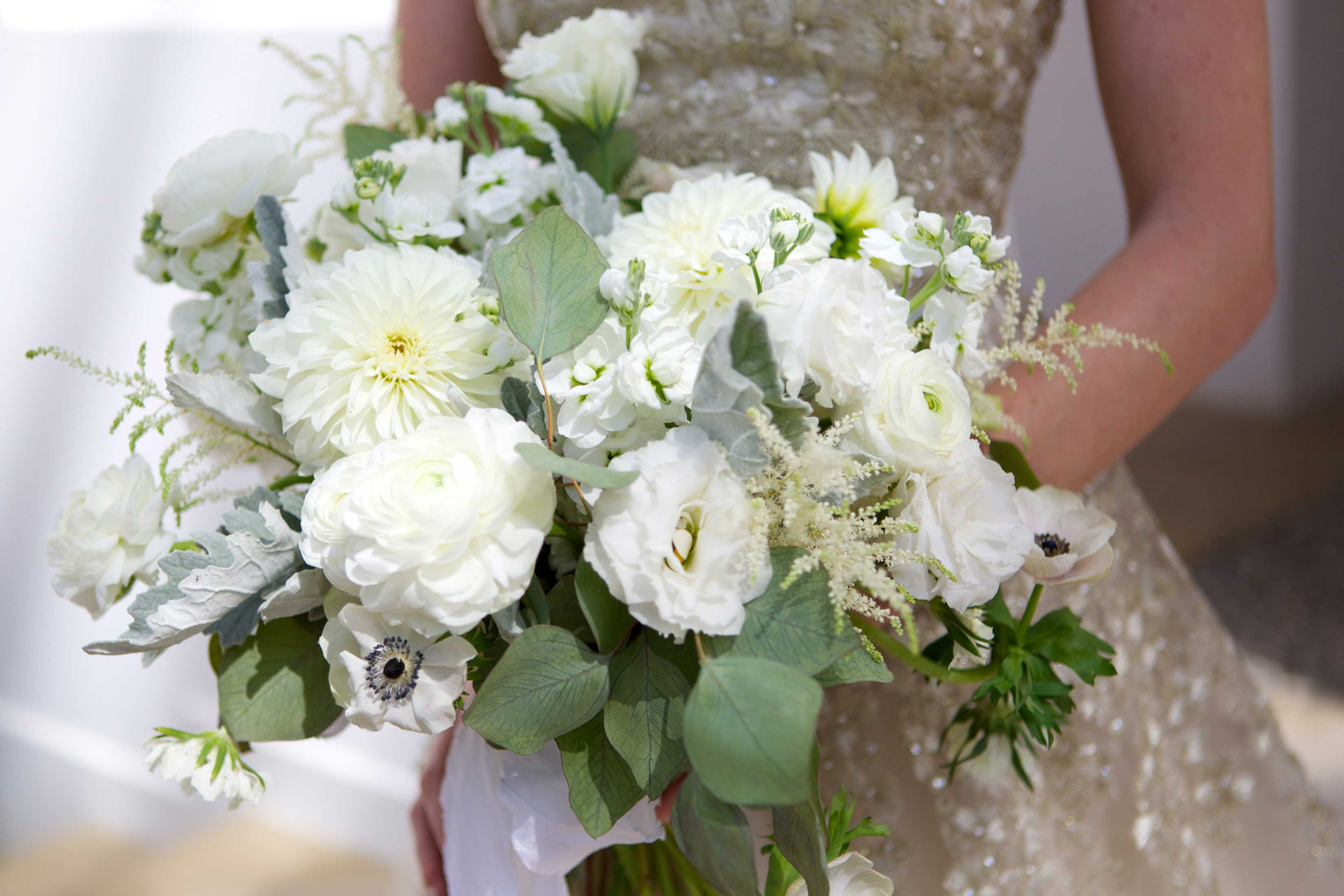 white bridal bouquet anemones, ranunculus, garden roses, and lisianthus, lots of greenery