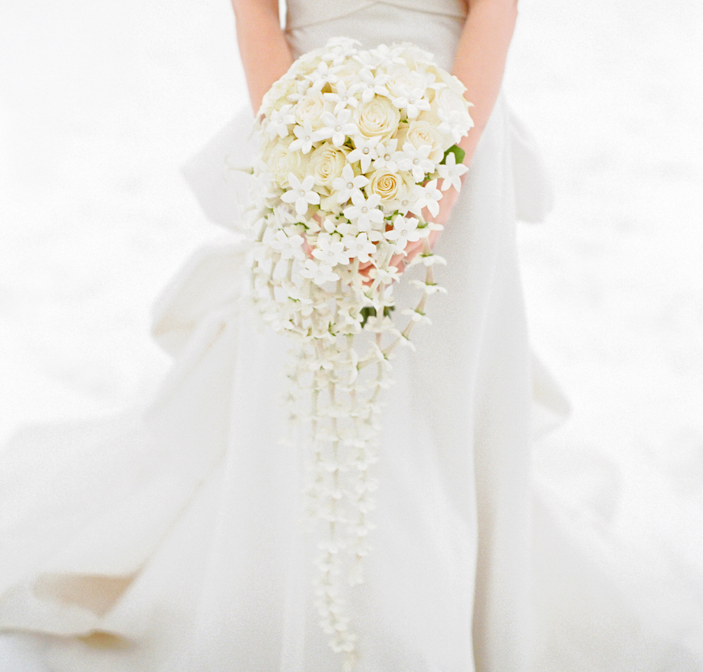 white bridal bouquet ivory roses and stephanotis blossoms dotted with pearls