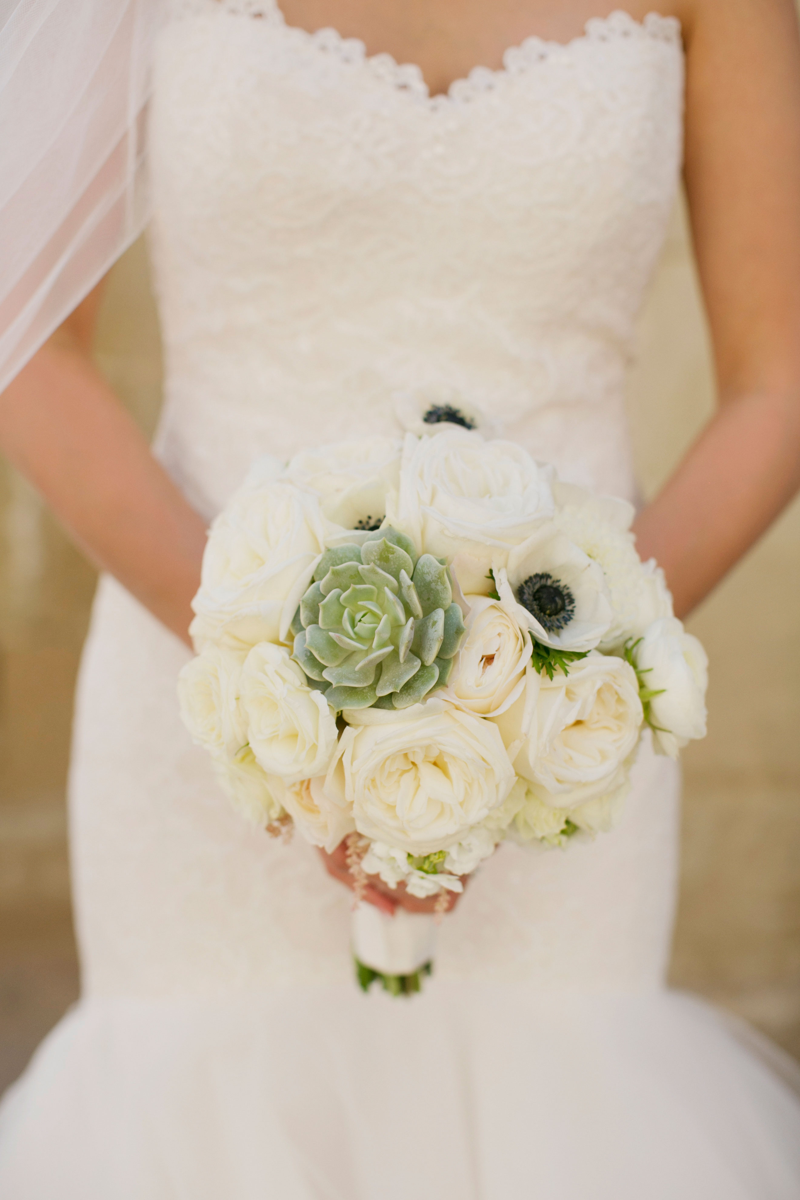 modern white bridal bouquet with garden roses and succulent