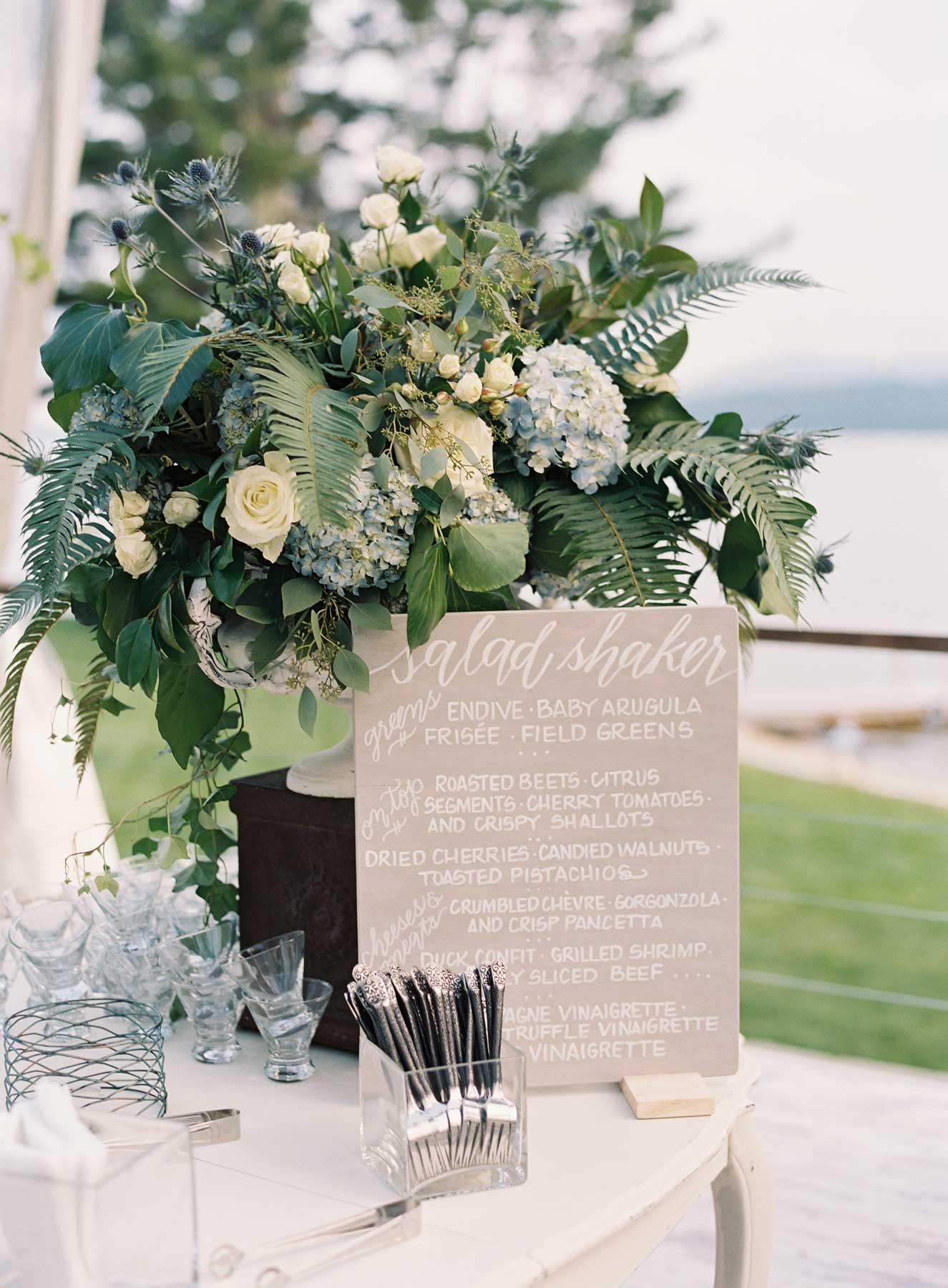 Blue grey decor blue hydrangea flower arrangement by grey white calligraphy salad menu station buffet reception