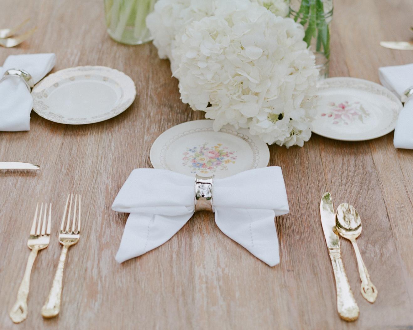wedding bow details, white napkin with chrome napkin ring forms bow