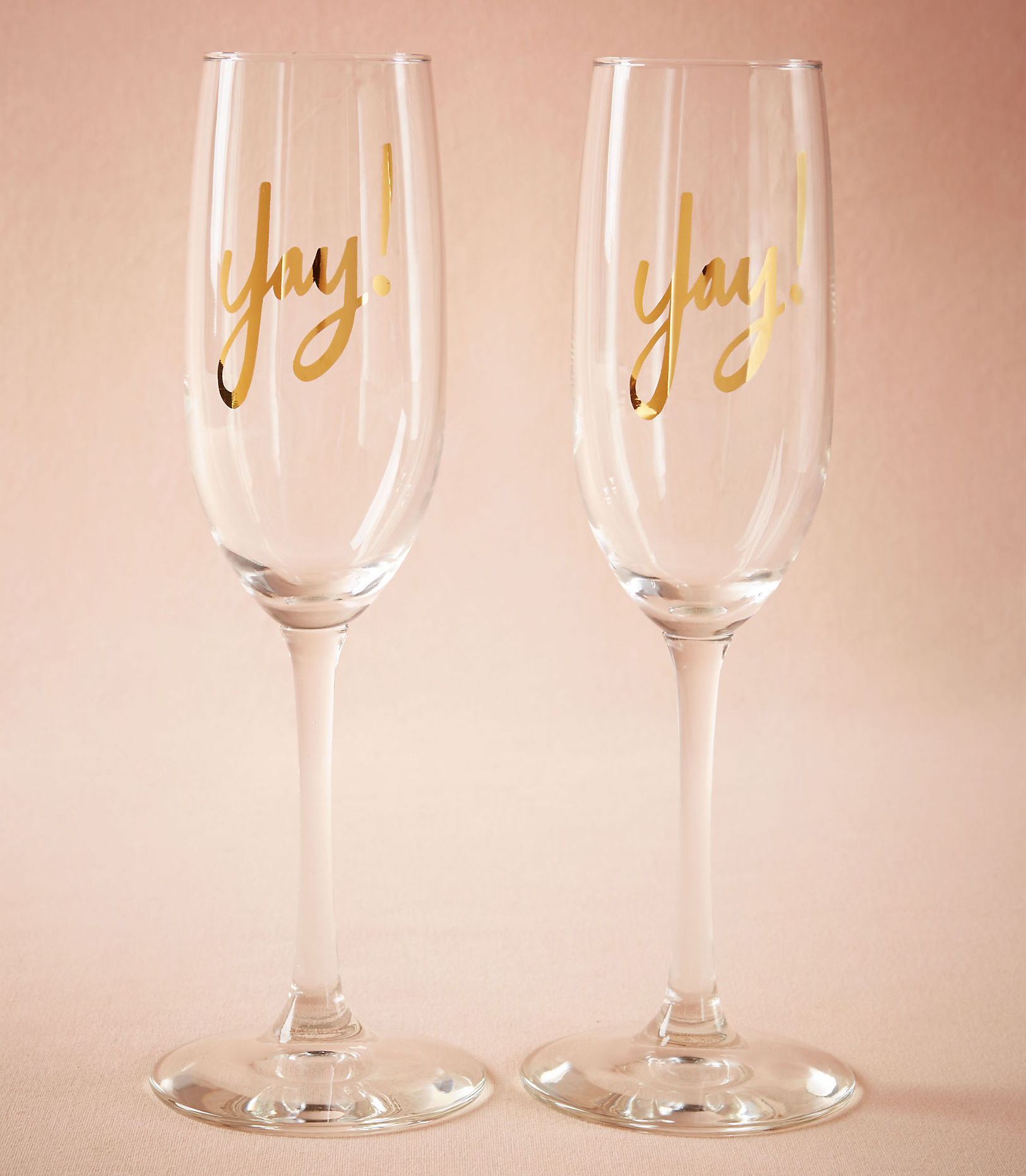 BHLDN Yay! Champagne flutes gold lettering engaged couple holiday gift idea