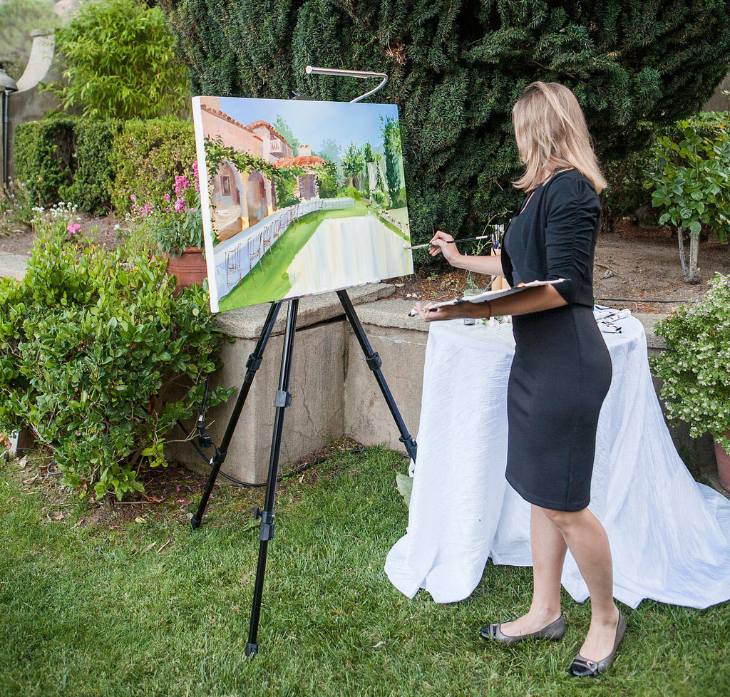 artist paints wedding reception
