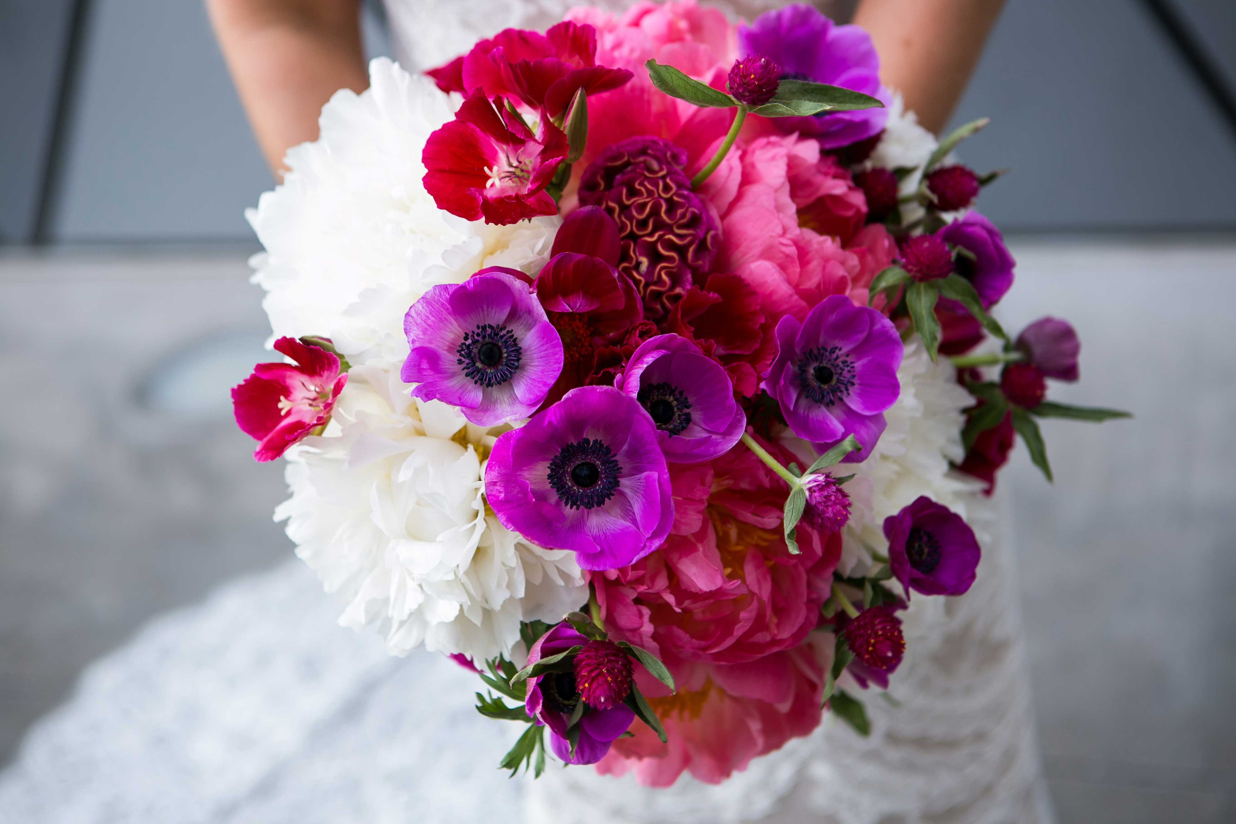 White flower pink peony fuchsia cockscomb purple anemone floral bridal bouquet dark moody color palette