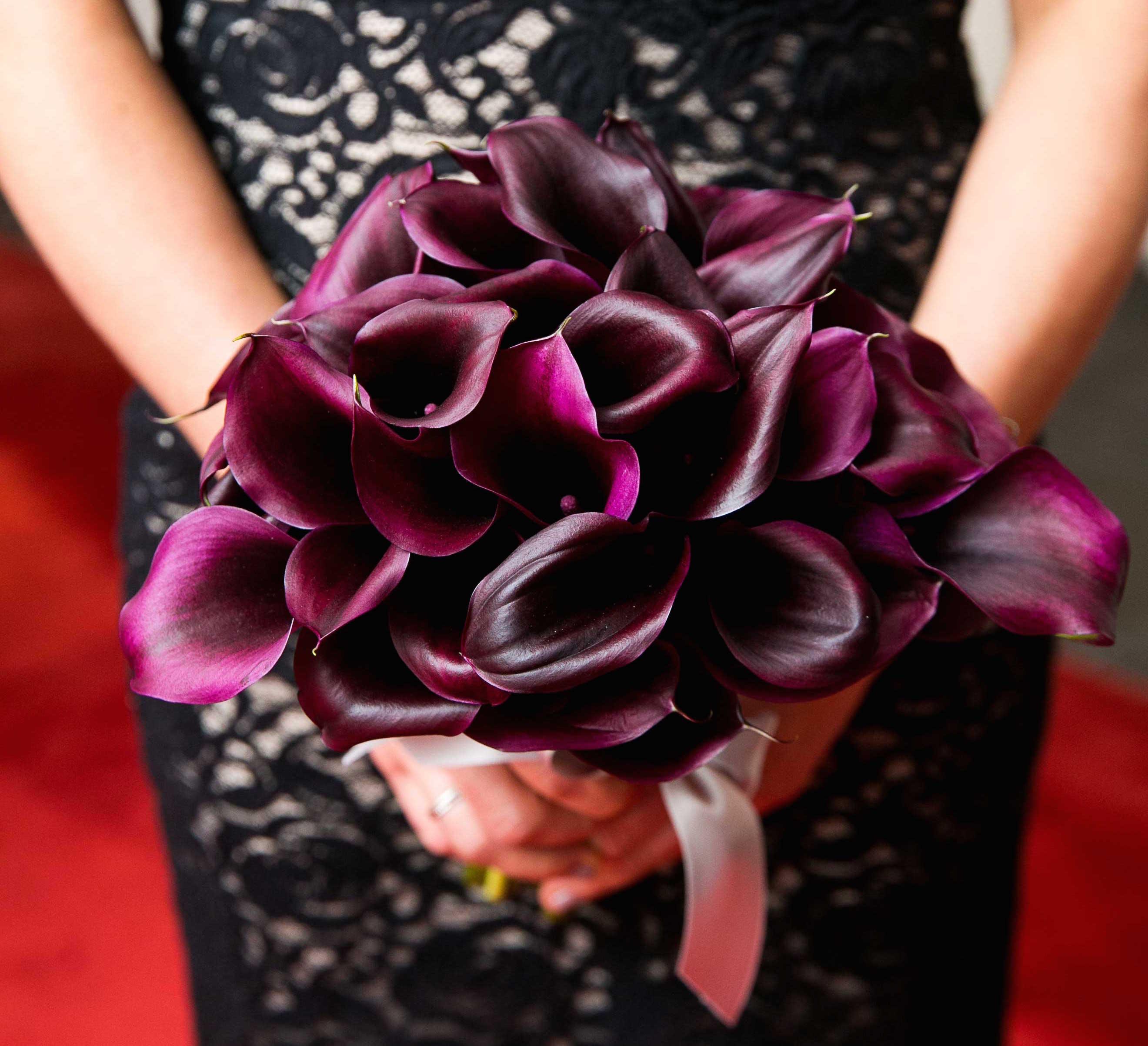 Bridesmaid dress dark black lace holding dark purple calla lily bouquet