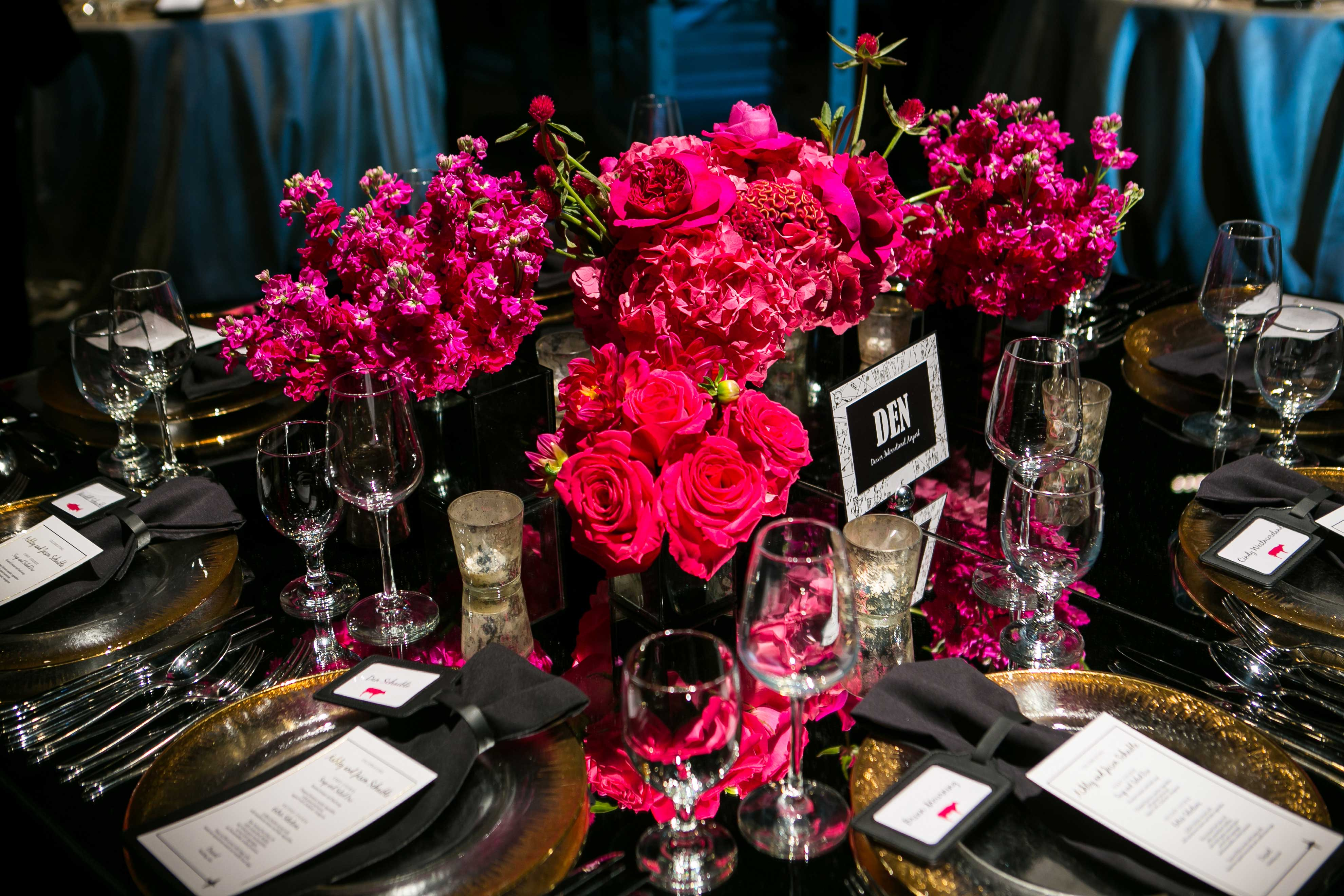 Dark and moody wedding color palette black linen napkins bright pink flowers