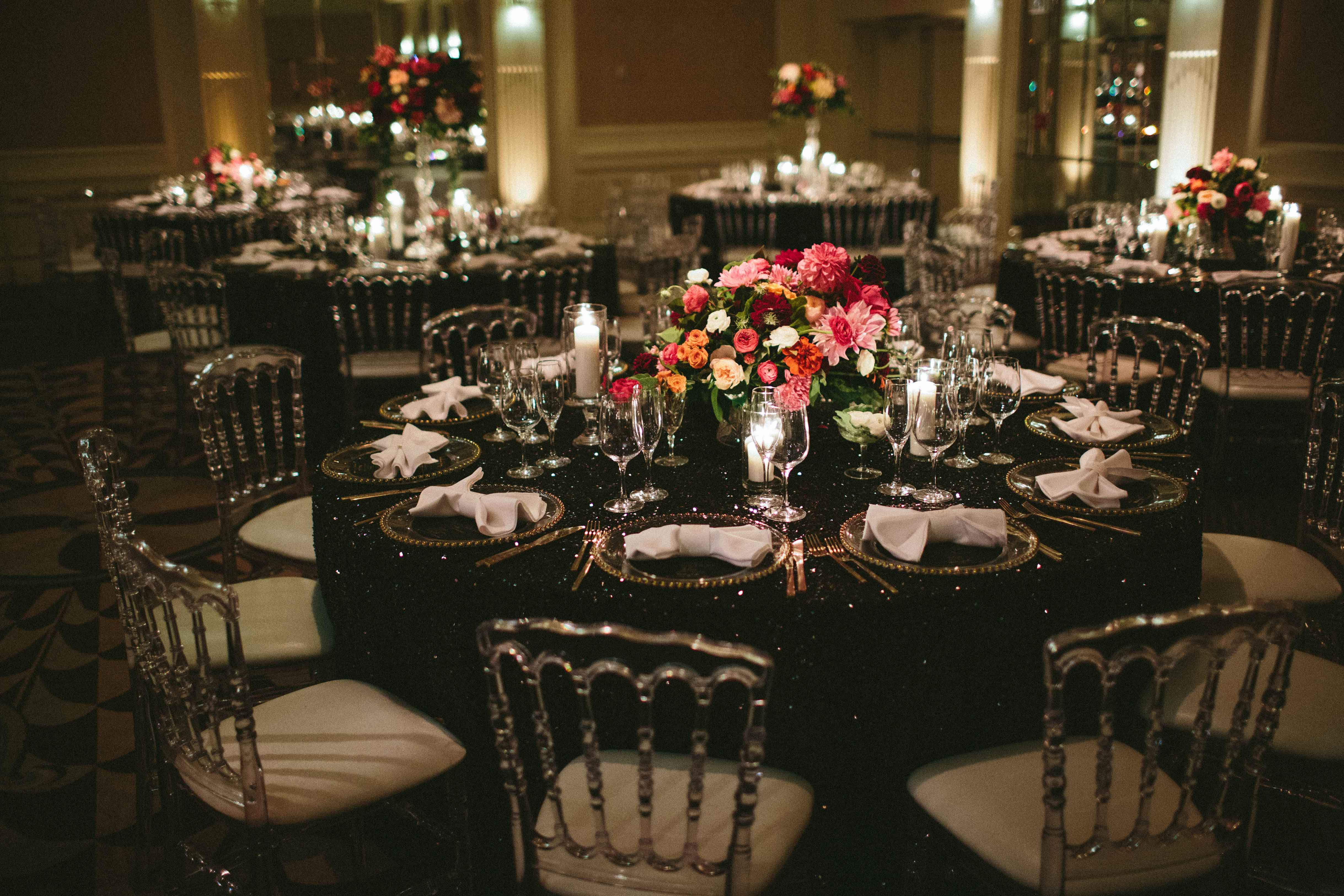 Dark sequin black table linens reception dark and moody decor and florals color palette
