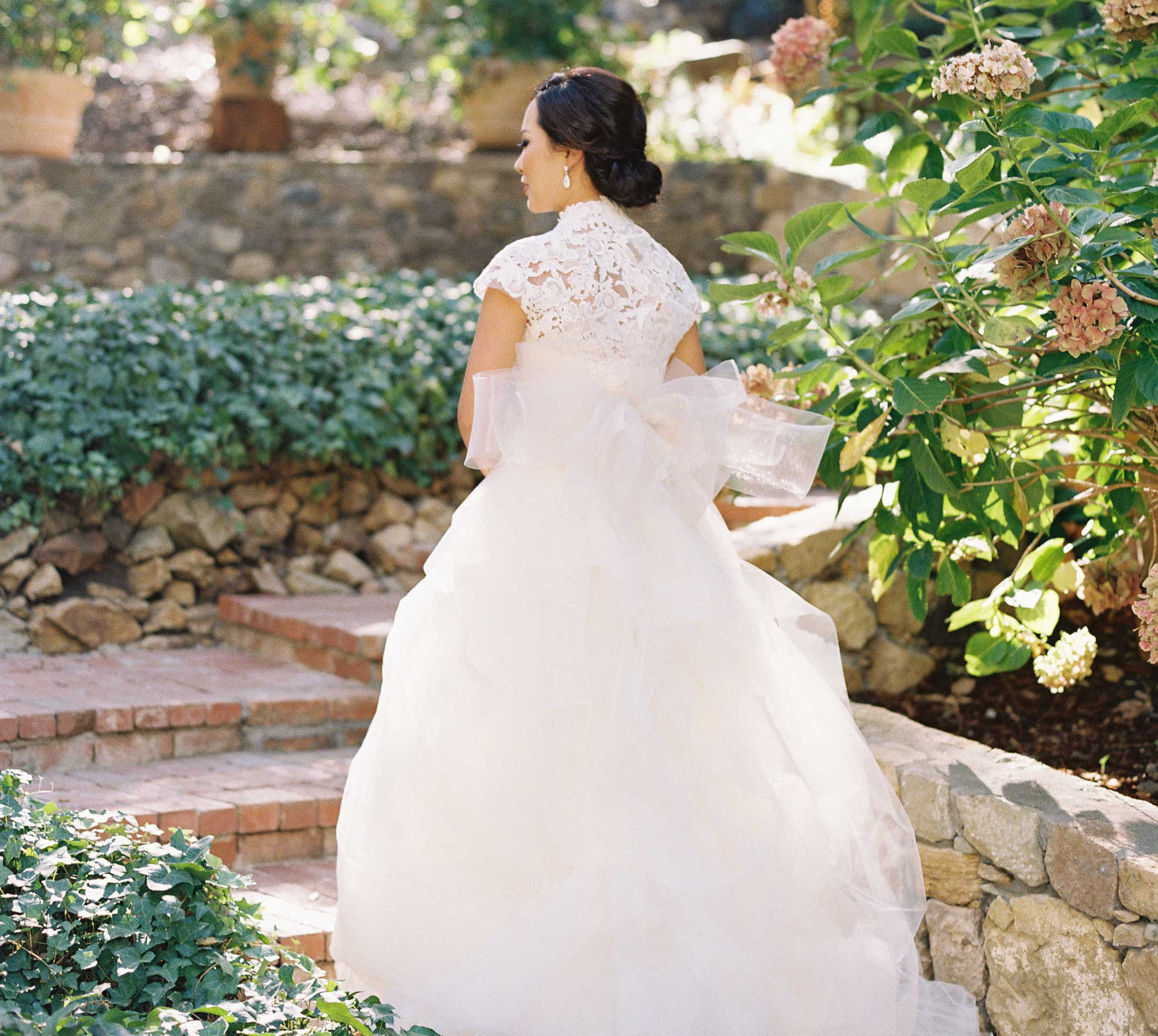 bride in vera wang ball gown with high neck lace bodice large tulle bow