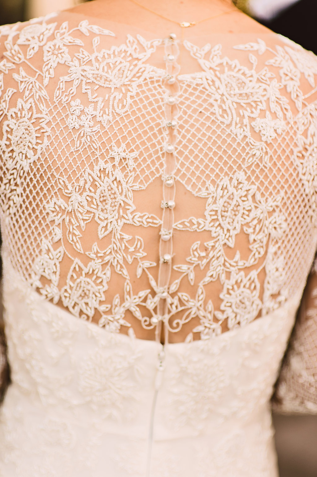 monique lhuillier wedding dress with detailed beading lace back close up