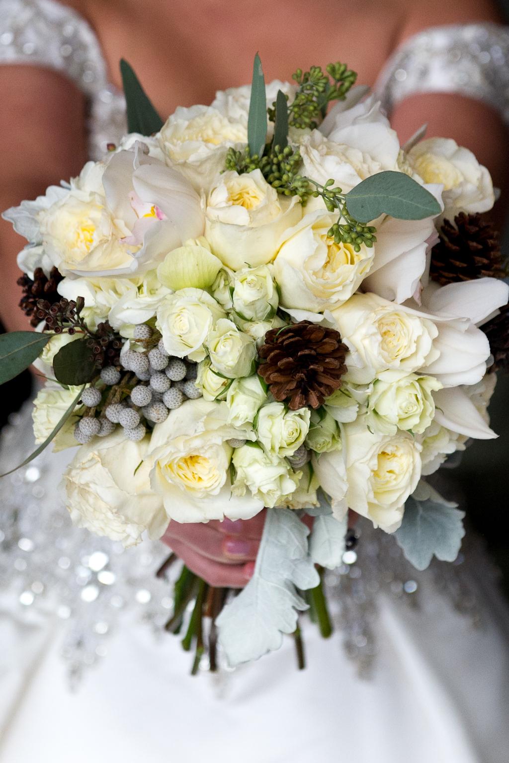Winter wedding bouquet idea pinecone white flower berries greenery