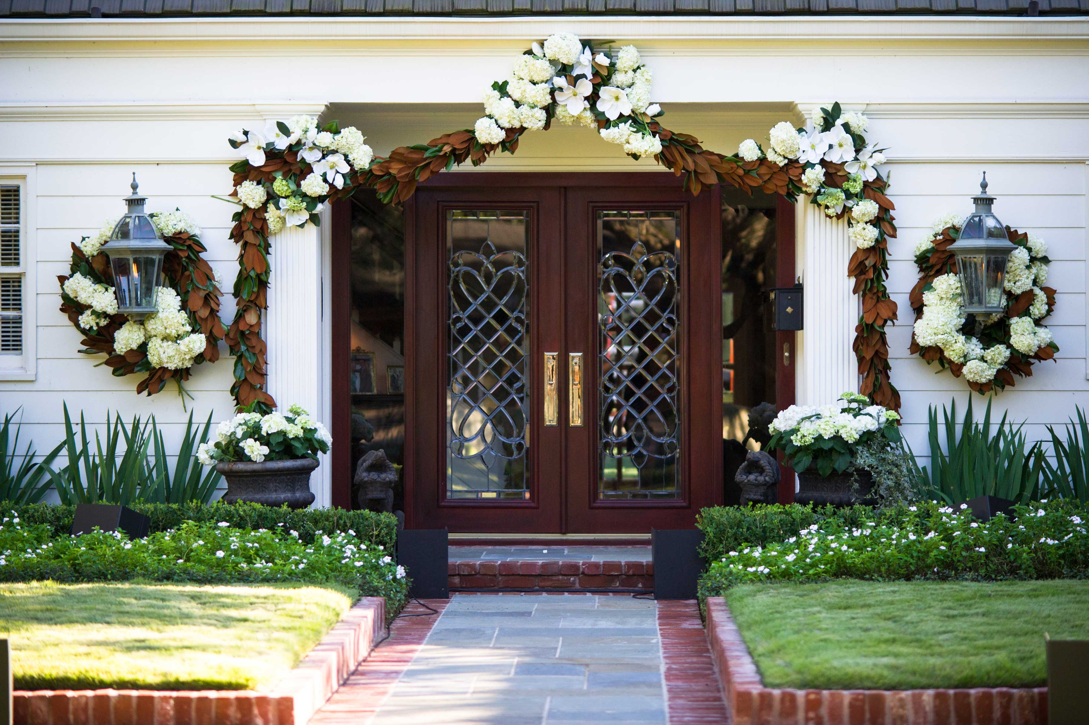 Hydrangea and magnolia leaf wreath decor on house at home wedding