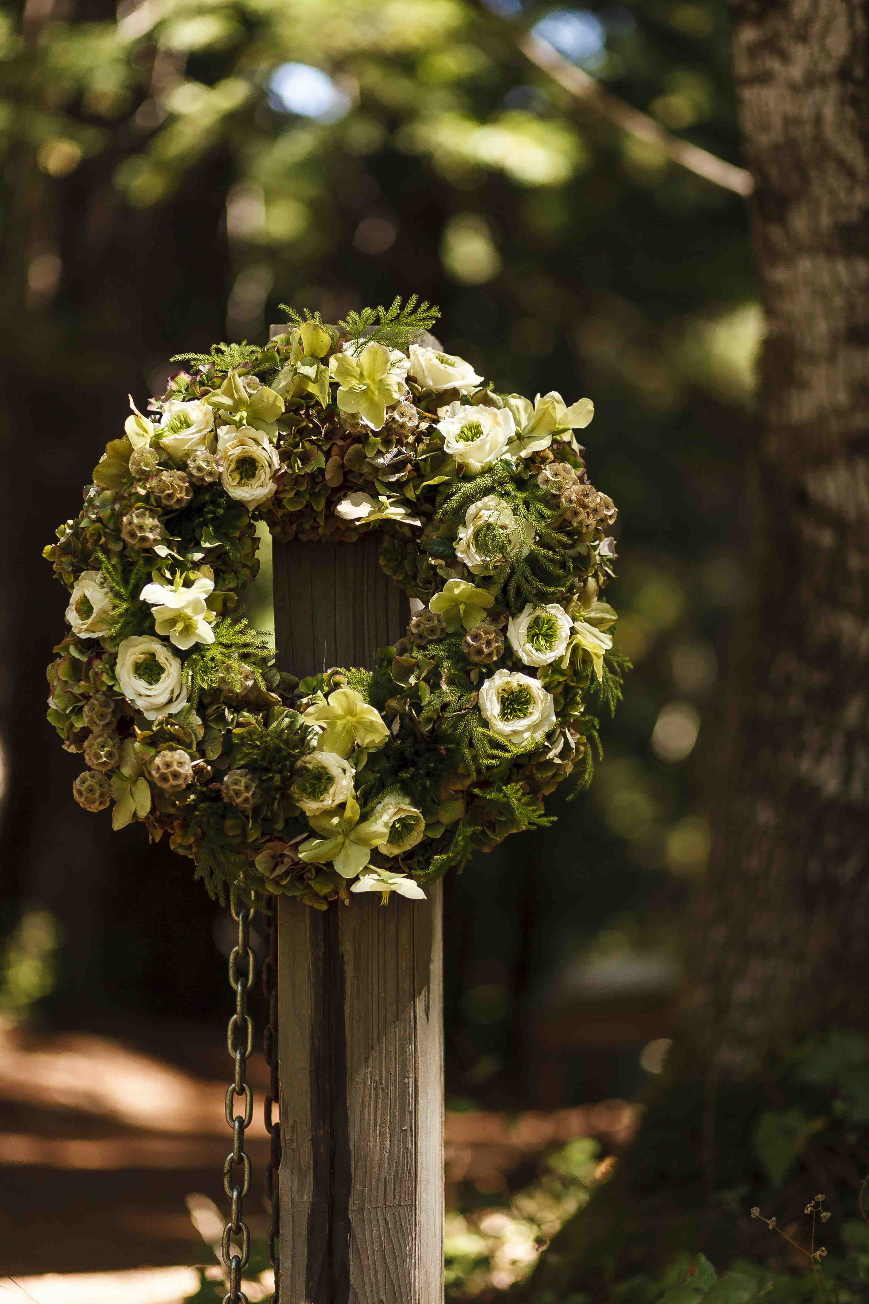 Rustic wedding ceremony forest venue wreath decor