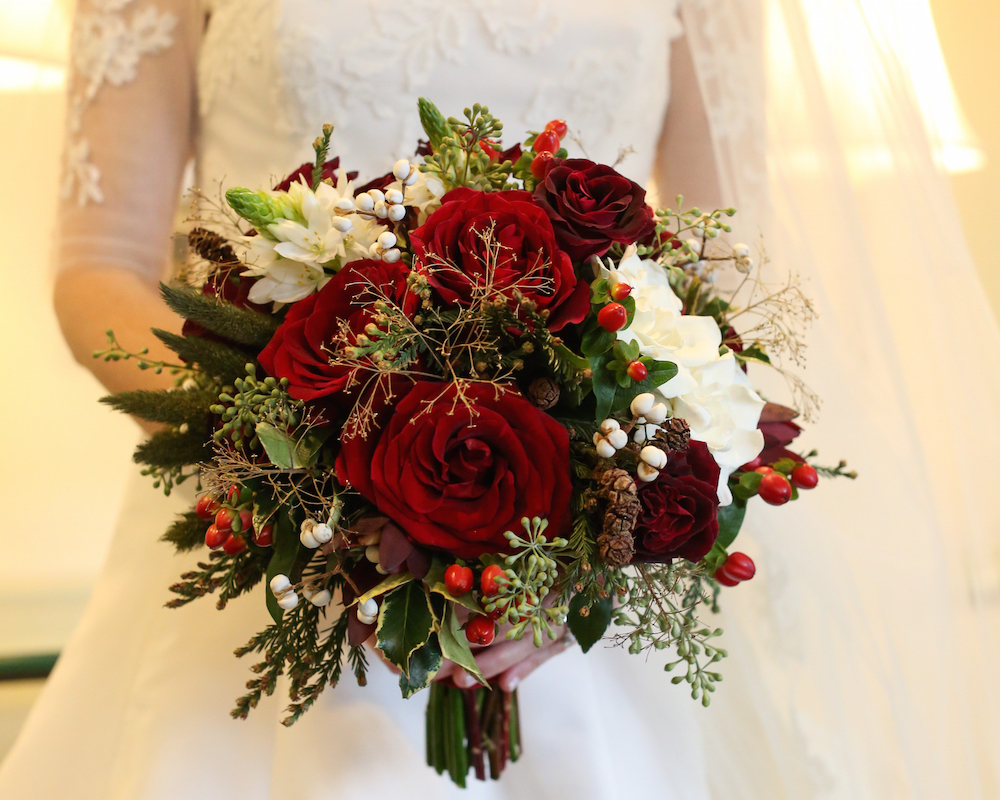 Winter wedding bouquet ideas red rose greenery white small mini pinecones