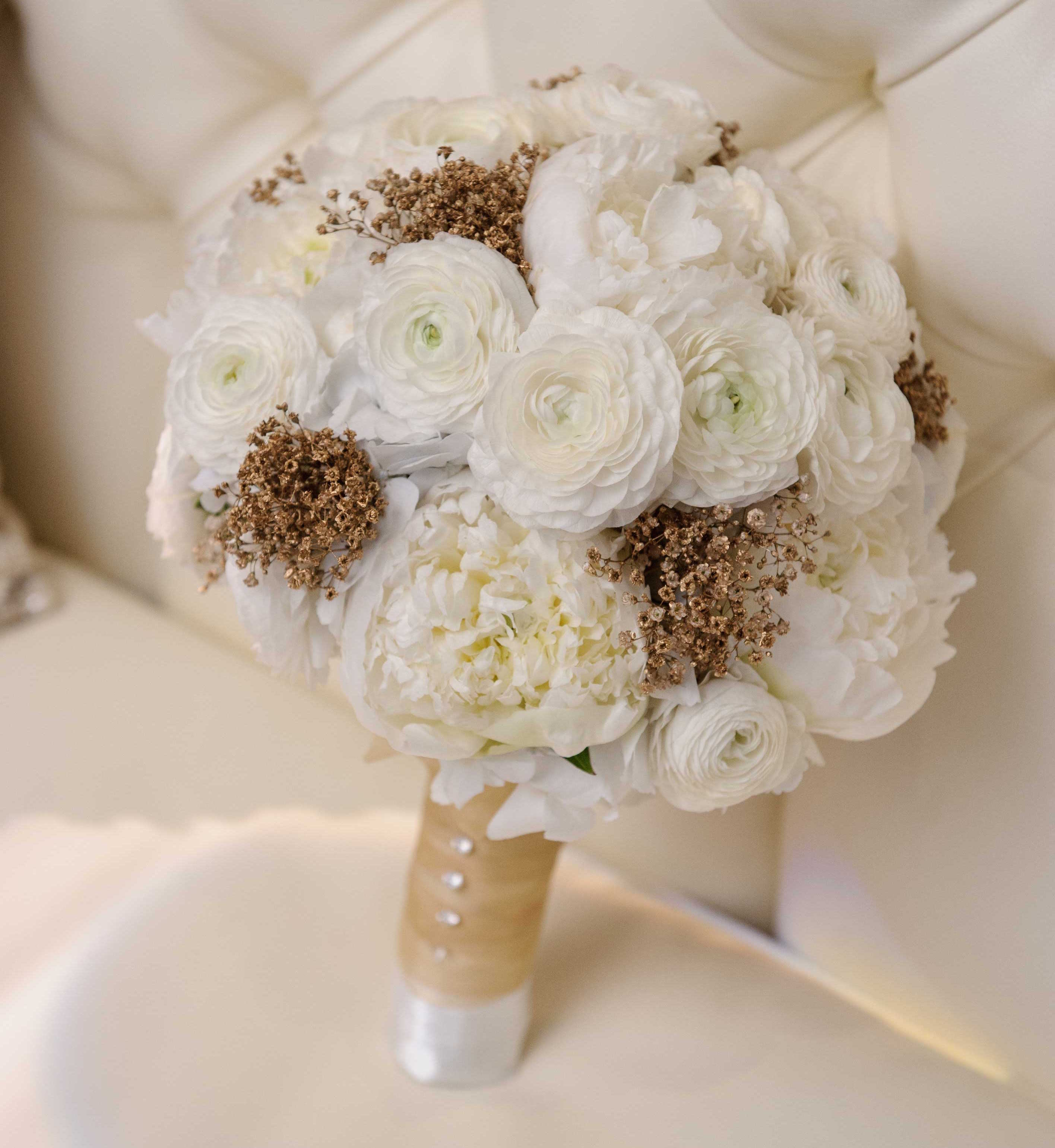 Winter wedding bouquet ideas white peony white ranunculus gold baby's breath