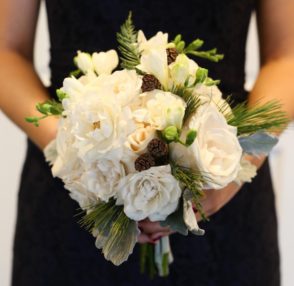 Winter Wedding Bouquet Idea White Rose Gardenia Pinecones Pine Needles Evergreen