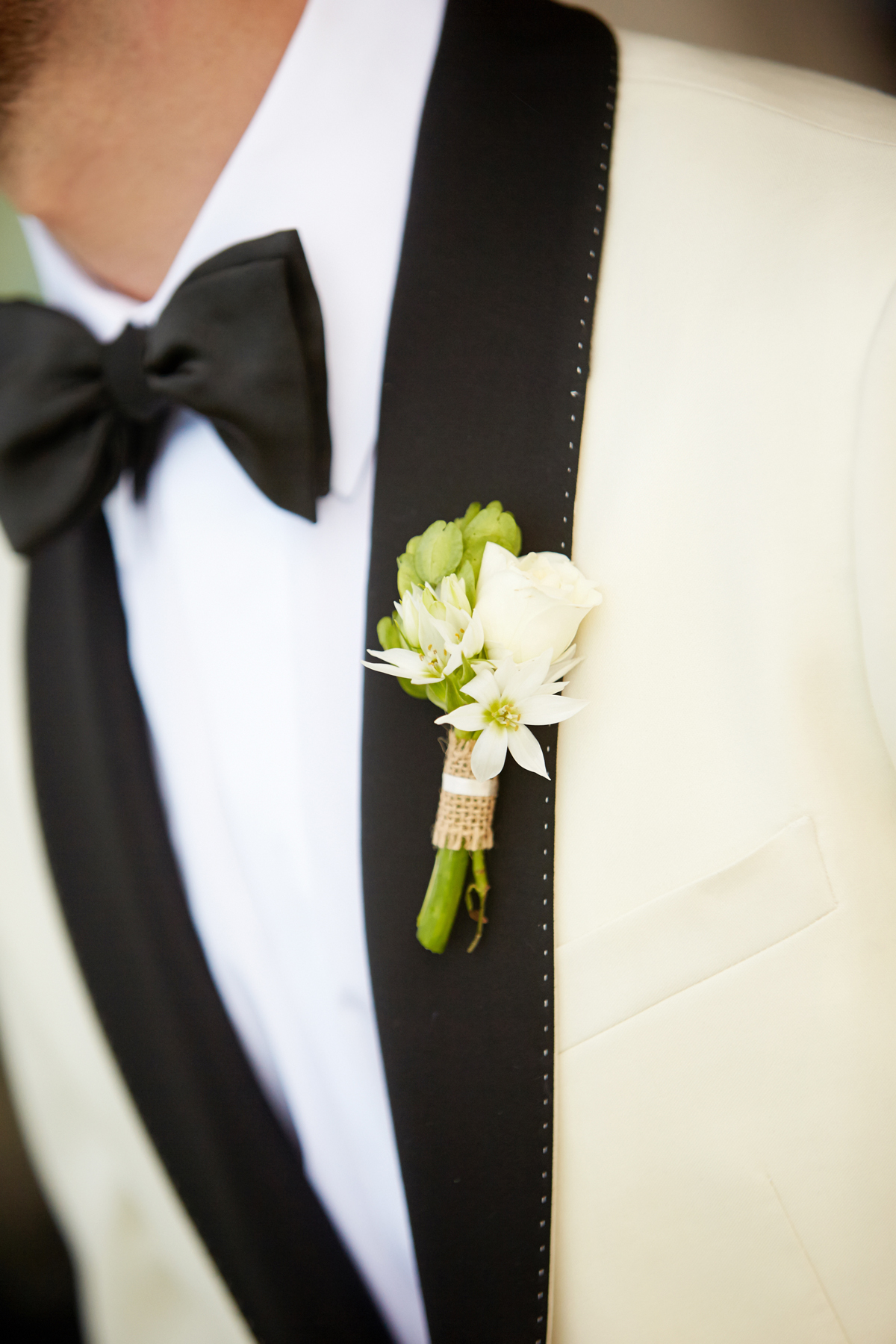 Pantone's 2017 Color of the Year greenery inspiration White tuxedo jacket white and green boutonniere with burlap