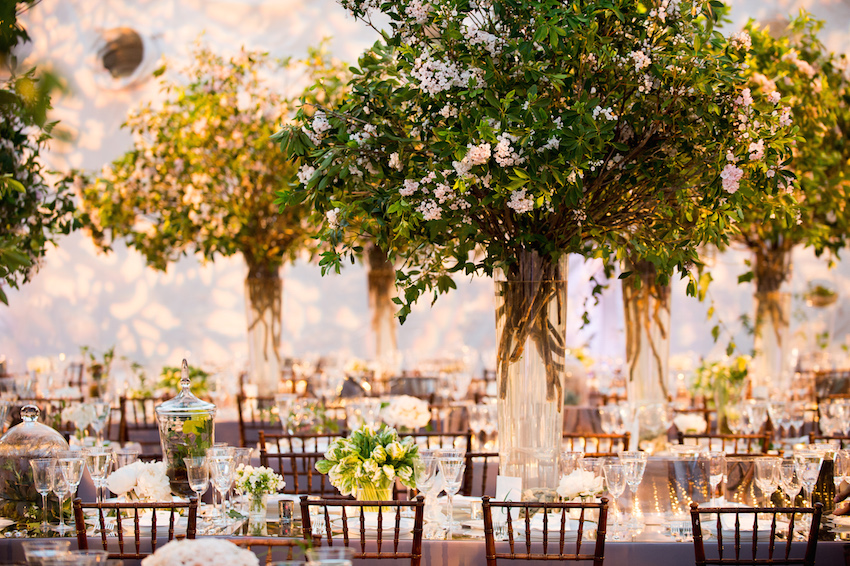Indoor wedding reception with tall greenery plant centerpieces Pantone's 2017 Color of the Year inspiration