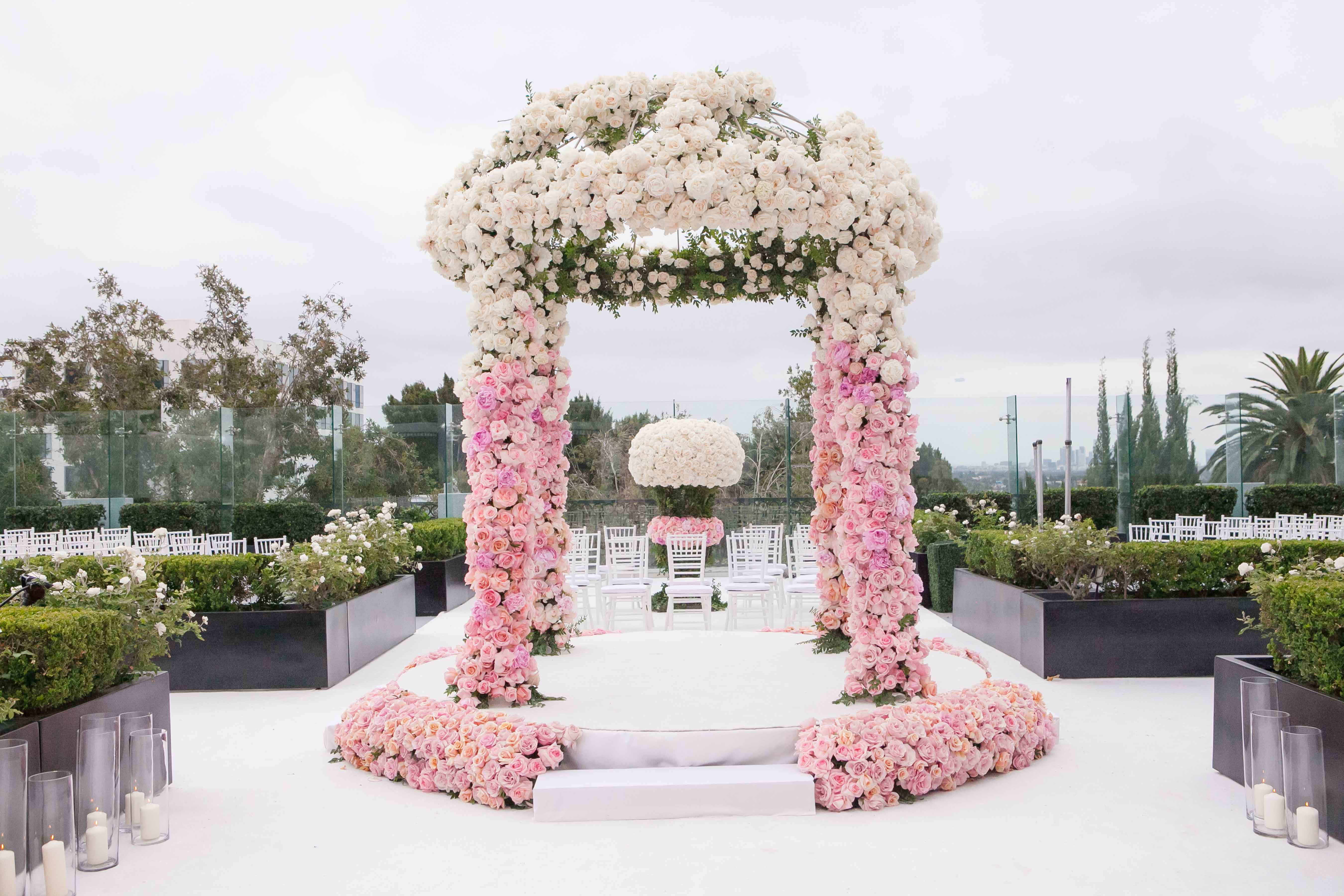 Pink and white flowers ceremony arch for outdoor wedding Los Angeles The London gay wedding Inside Weddings winter 2017 issue