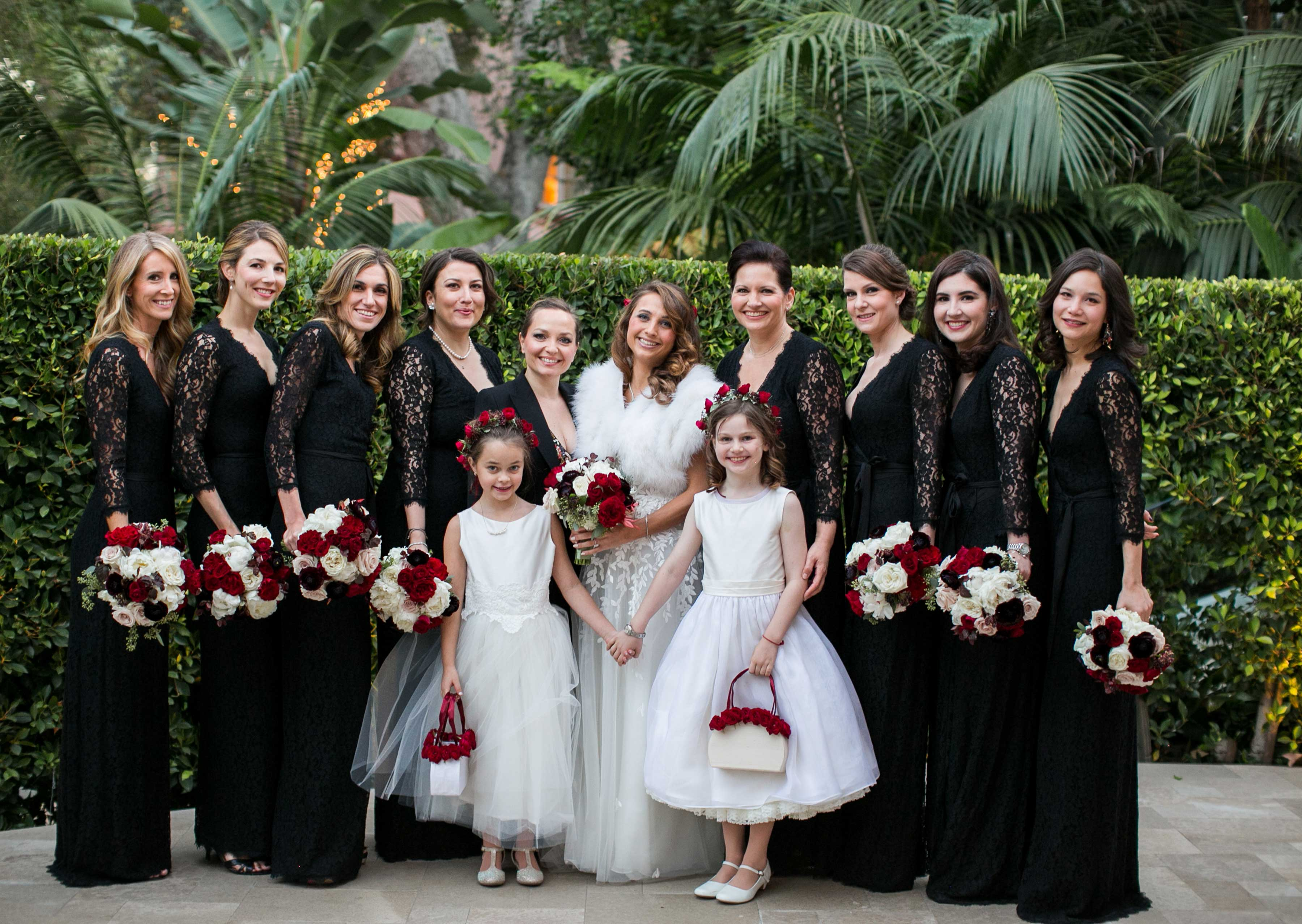 Christmas color wedding black bridesmaid dresses red flowers bride in fur shawl Inside Weddings winter 2017 issue