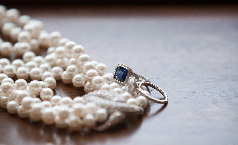 bradley cooper and irina shayk engaged, vintage sapphire asscher-cut ring with milgrain halo
