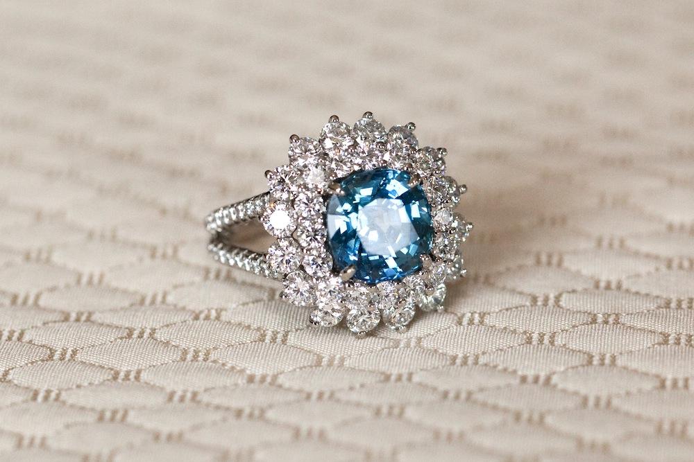 bradley cooper irina shayk engaged, blue diamond engagement ring with flower halo