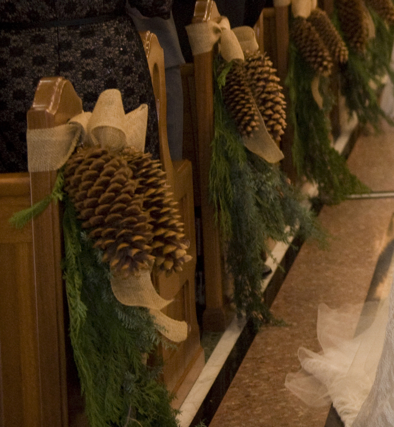 large pinecones and fir greenery aisle markers christmas holiday season wedding