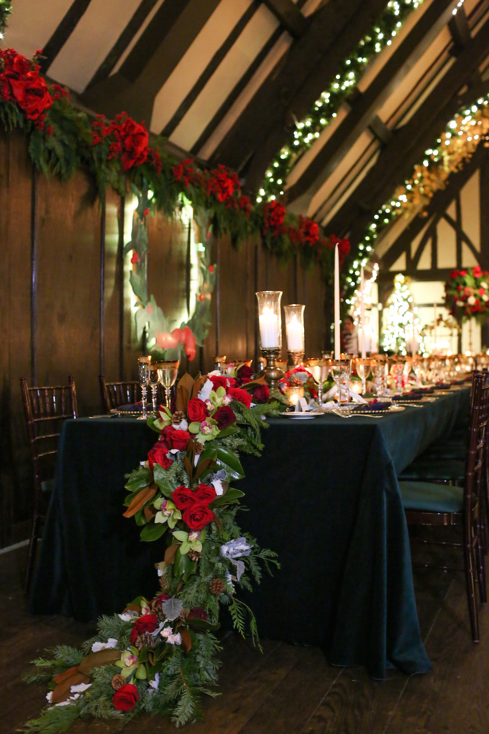 red roses, pine branches, pinecones, holiday season christmas wedding